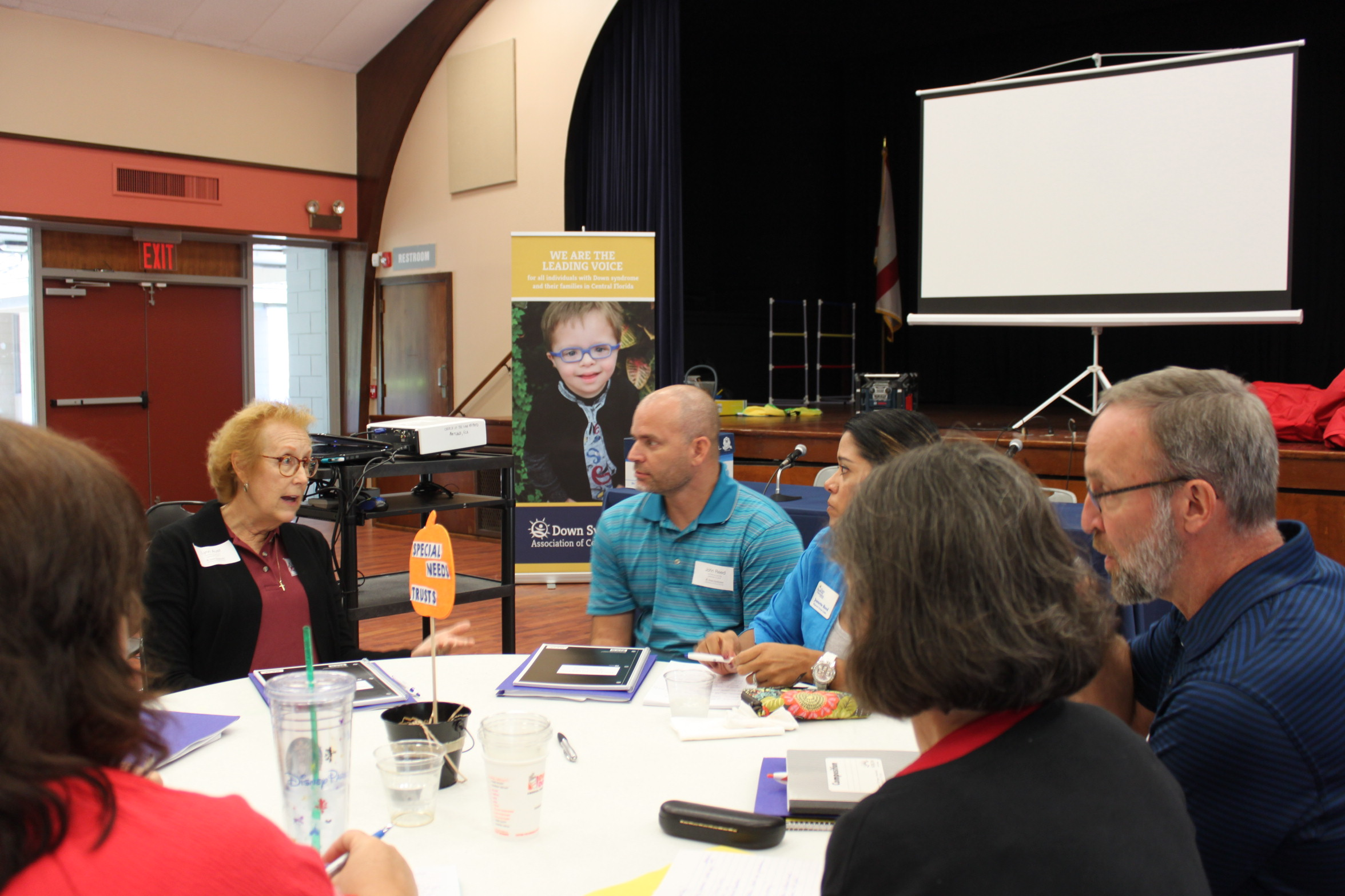 Attorney Lynn Aust answers questions about Special Needs Trusts at one of the roundtable discussion sessions.
