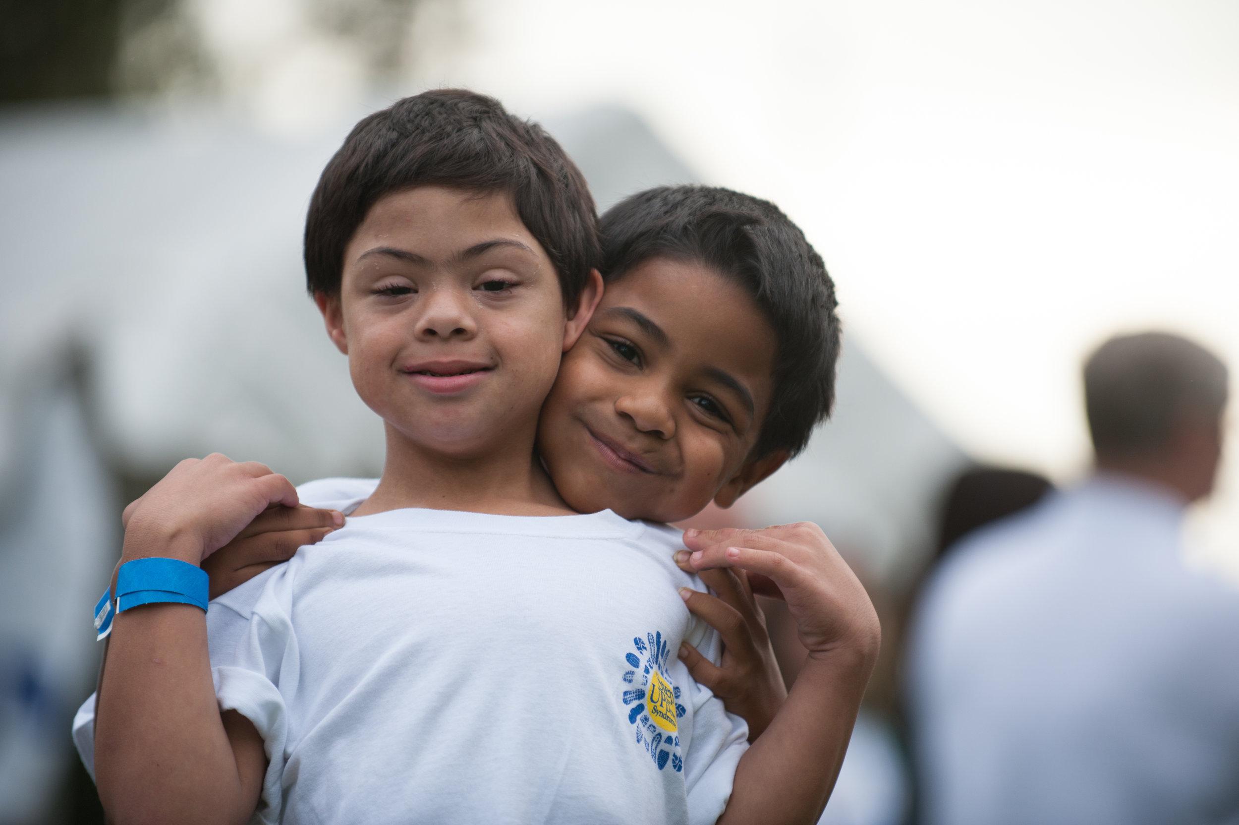 hispanic brothers over shoulder.jpg