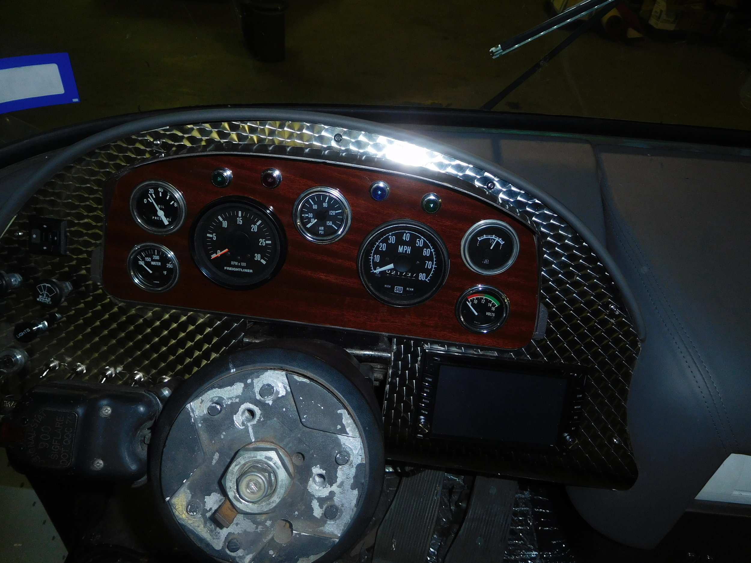 The new dash with mahogany insert and stainless engine turned panel