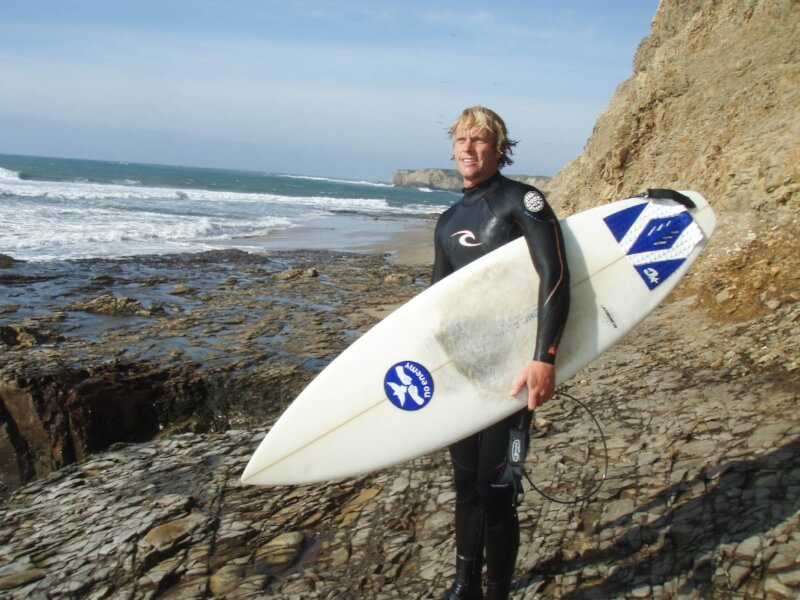 The Coast Ridge co-founder Yarrow Schley with surfboard.