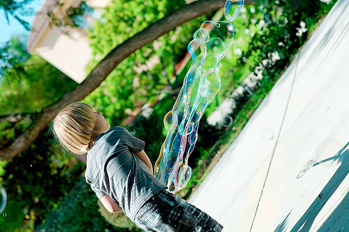 boy making bubble outside.jpg