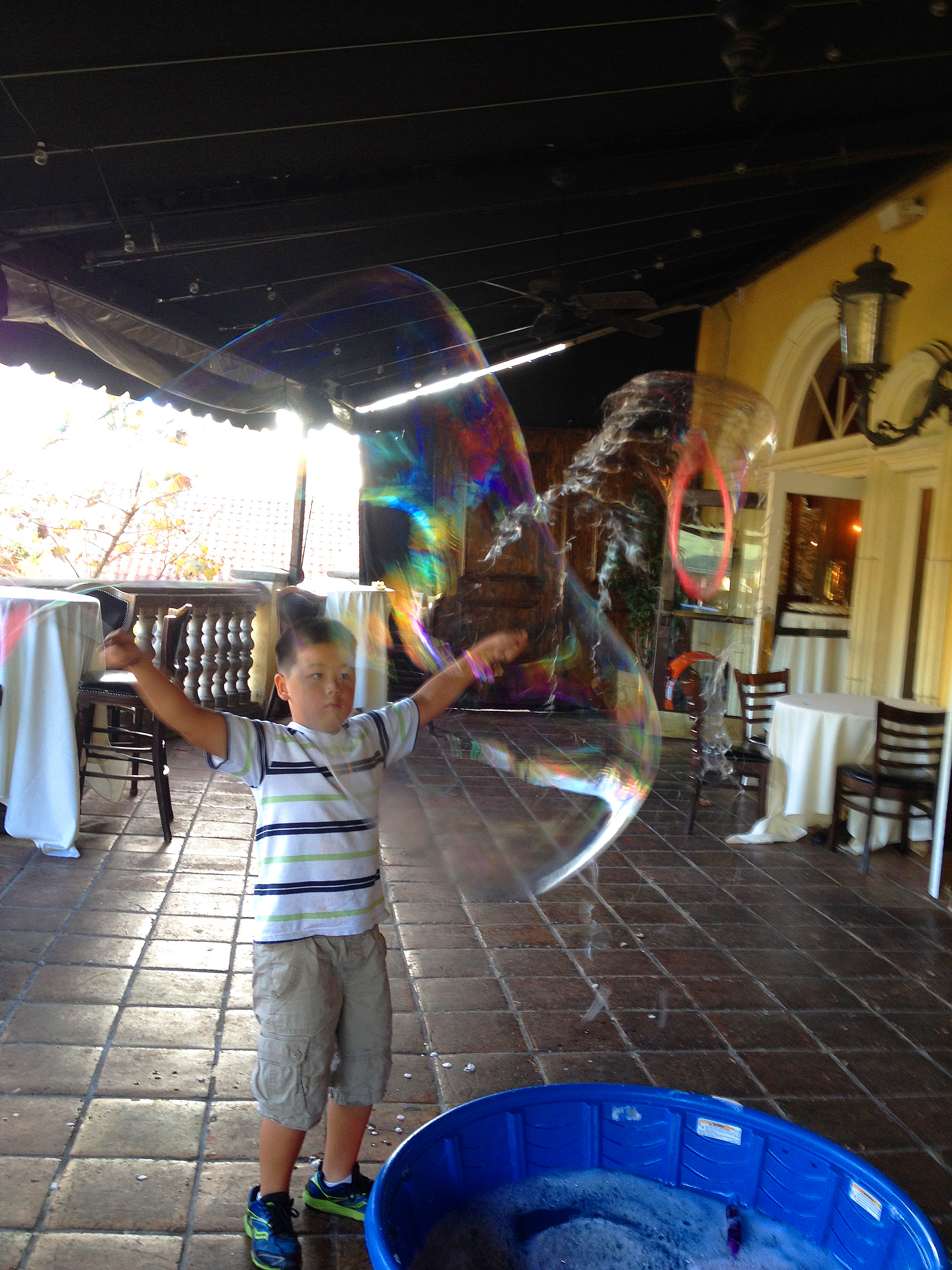 kid making bubbles at maggiano's.jpg