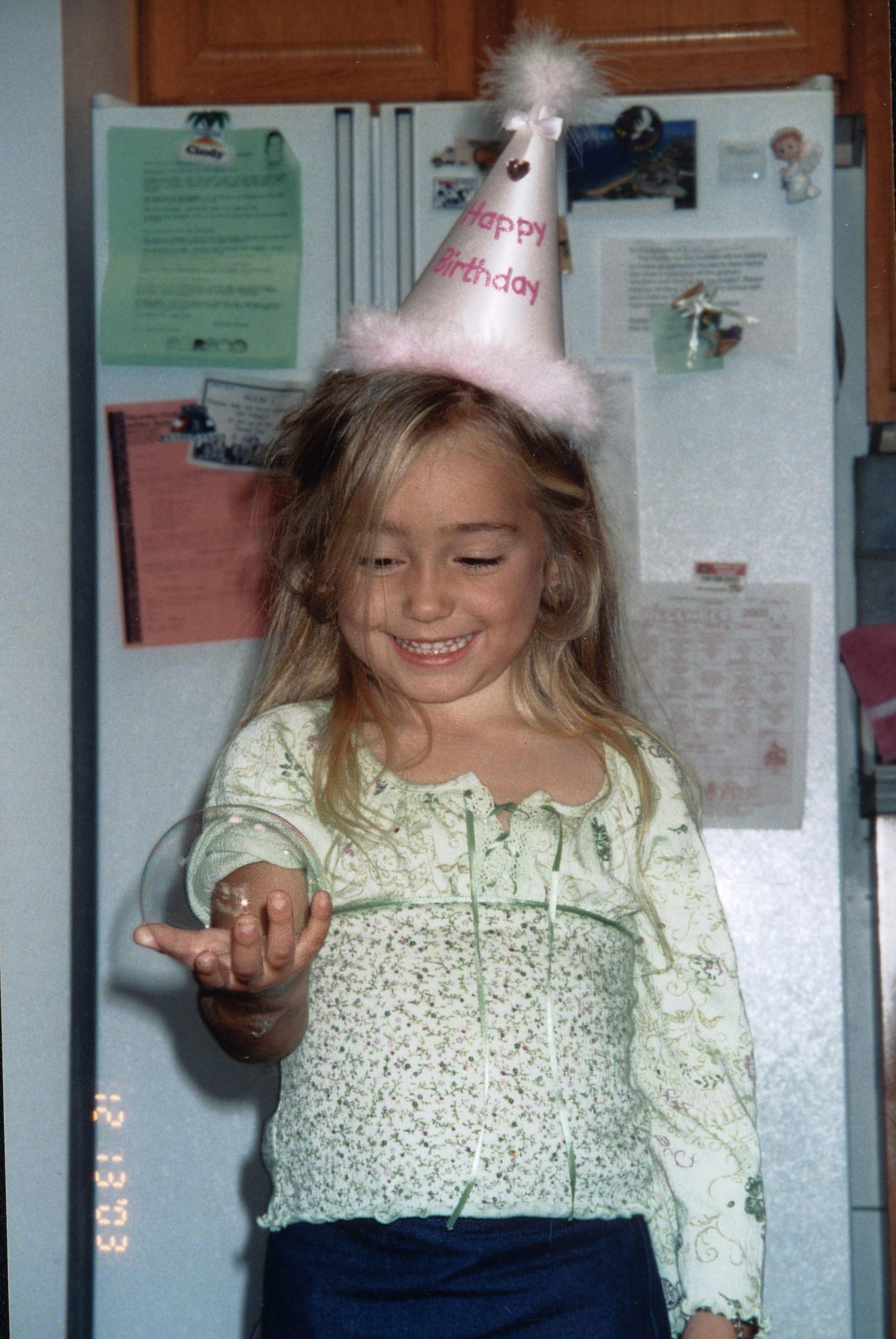 girl holding bubble.jpg
