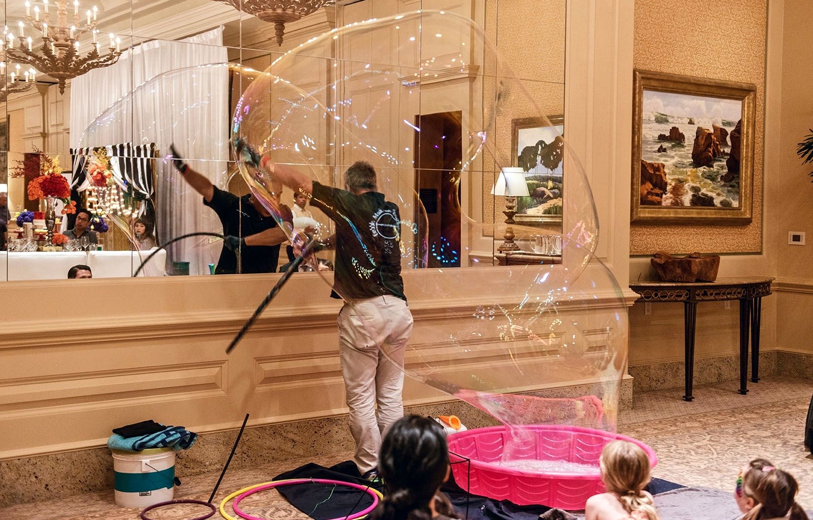 jilber doing big bubble at party.jpg