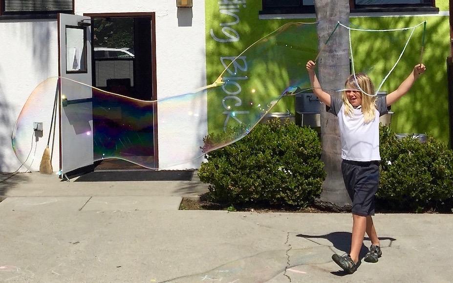boy making large bubble cropped.jpg