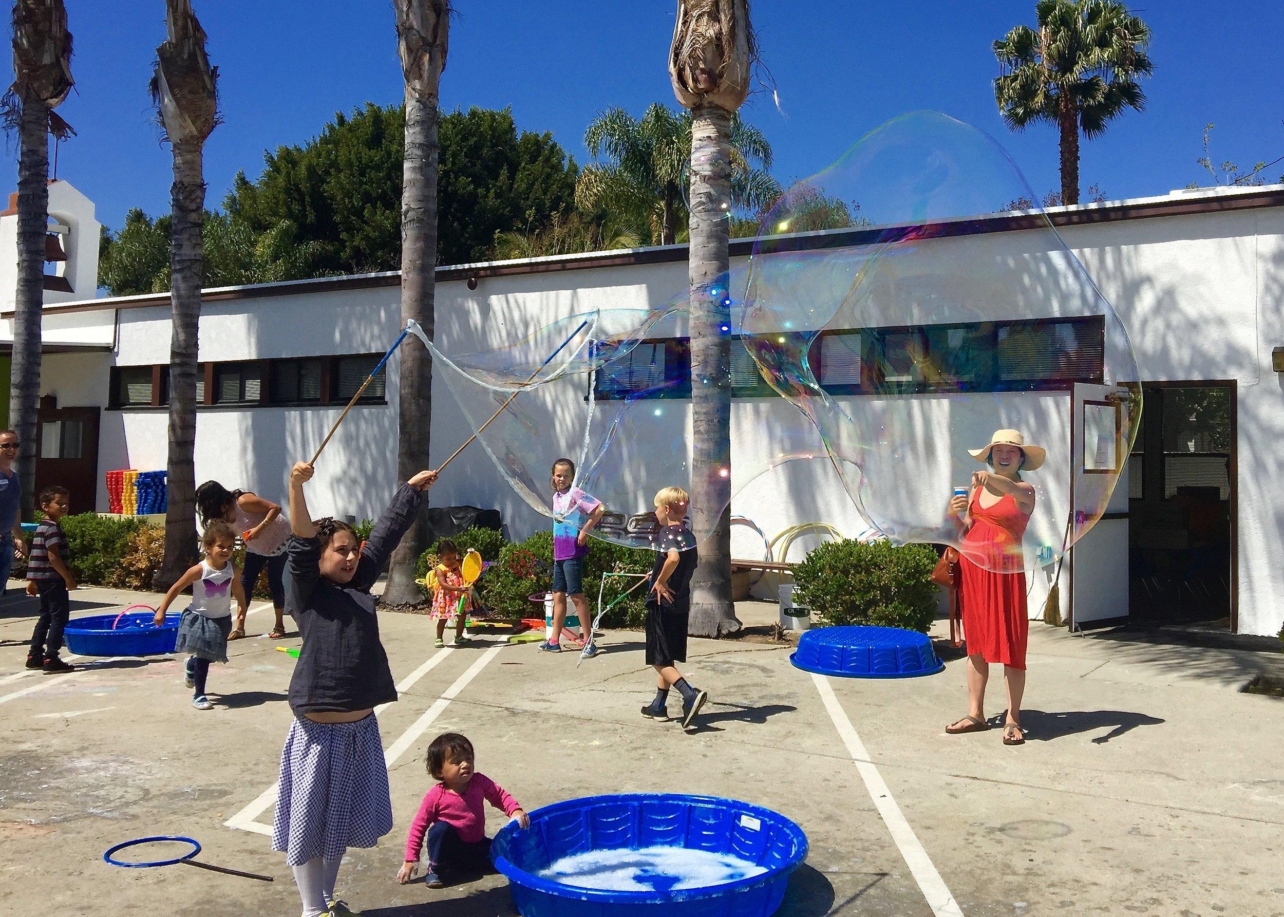 girl making large bubble.jpg