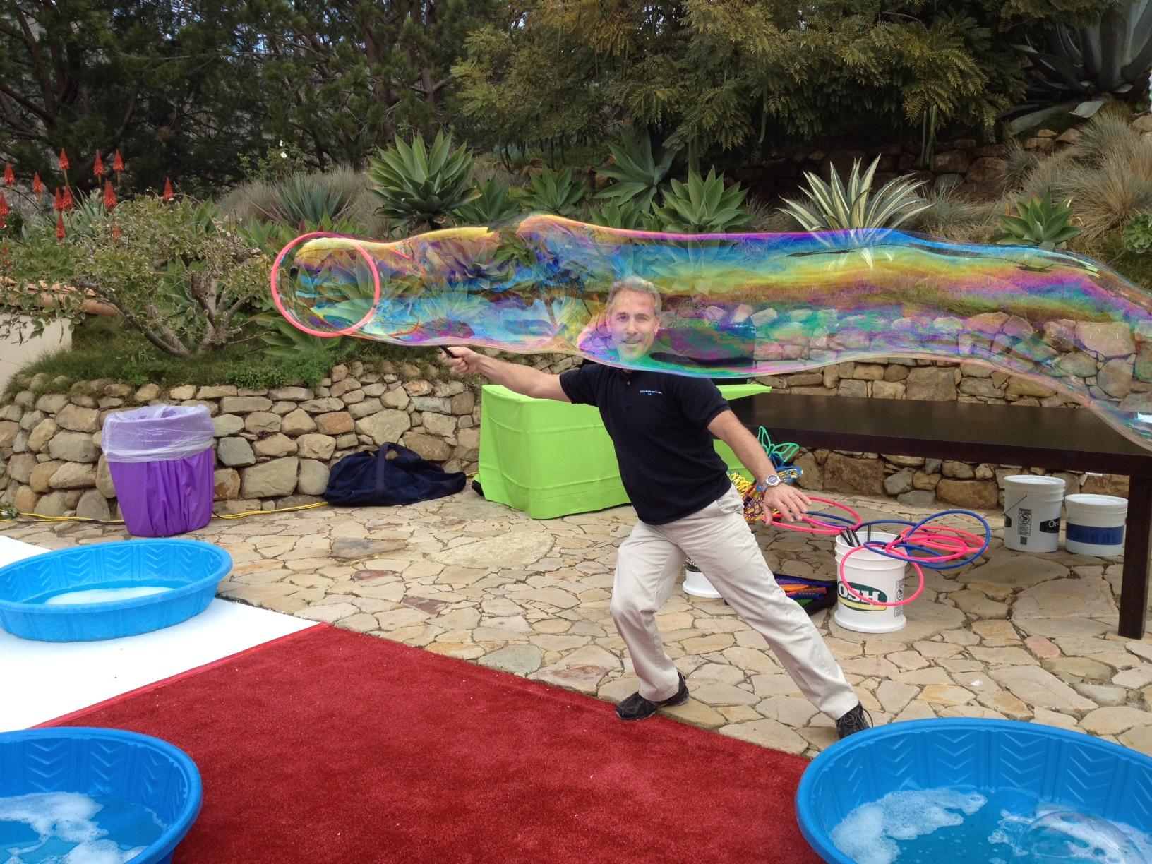 gigi making long tube bubble 2.JPG