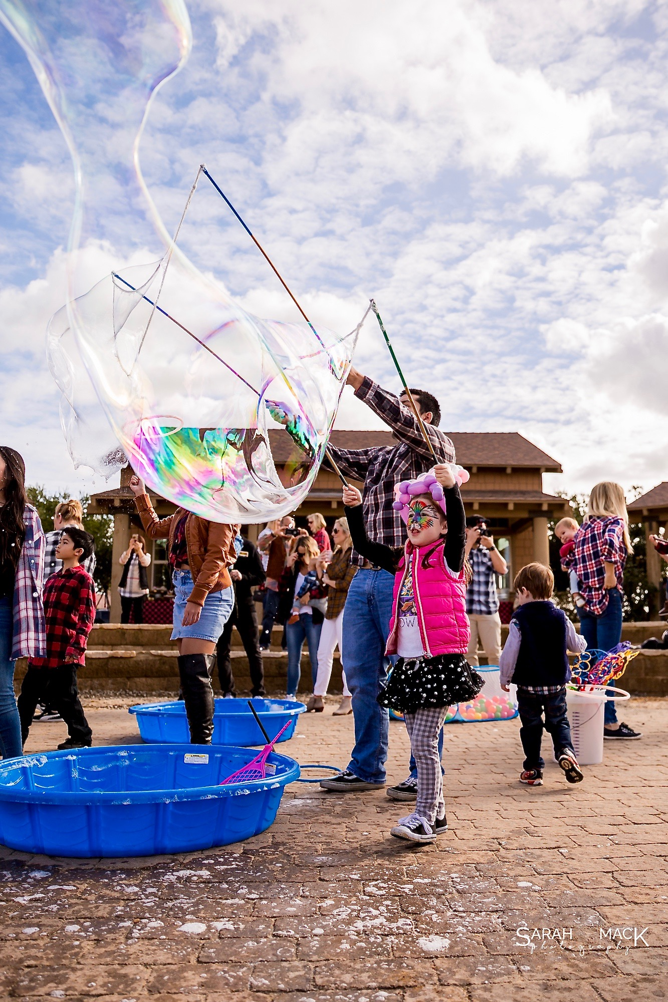 girl and dadd making giant bubbles.jpg