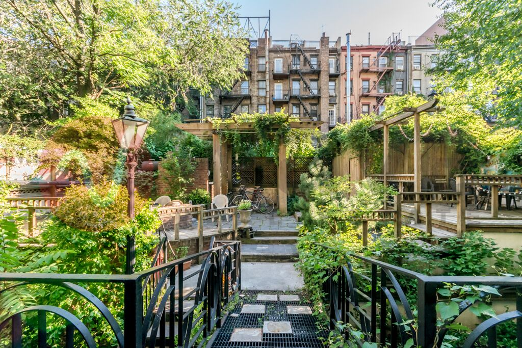 518 East 6th     Street -    This building consists of ten recently renovated walk-up apartments. A huge backyard deck allows you to enjoy the outdoors in complete privacy. Located on a peaceful residential block in the East Village.