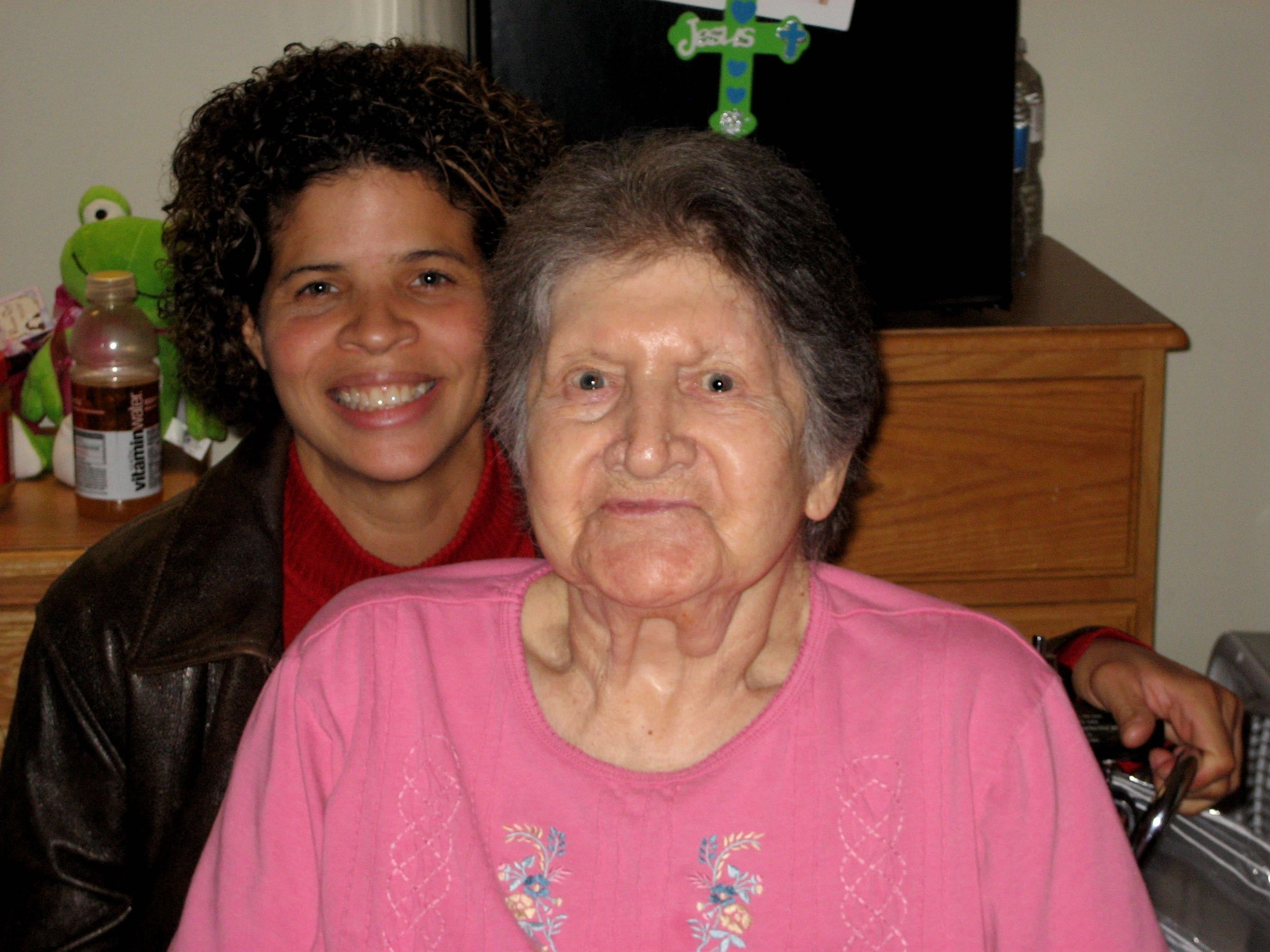 Jeffrey's sister, Shaina, with their mother, Betty Reddick.
