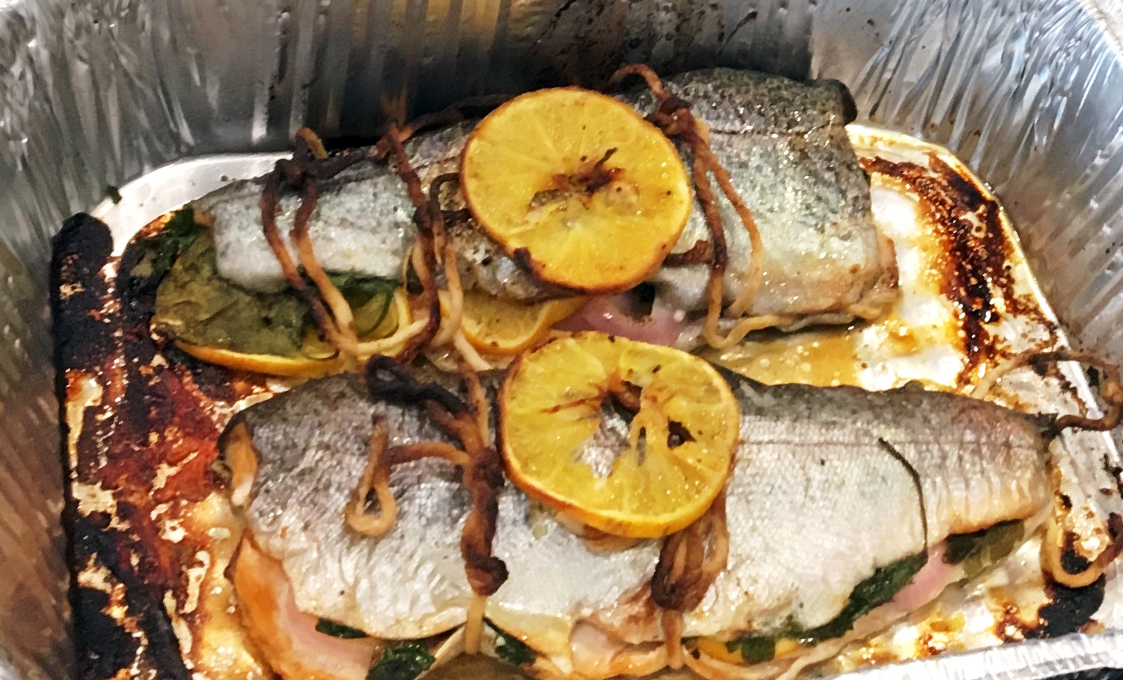 The trout, partially cooked.