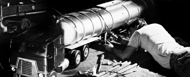 Joe Viskocil preparing miniature of tanker truck for explosion.