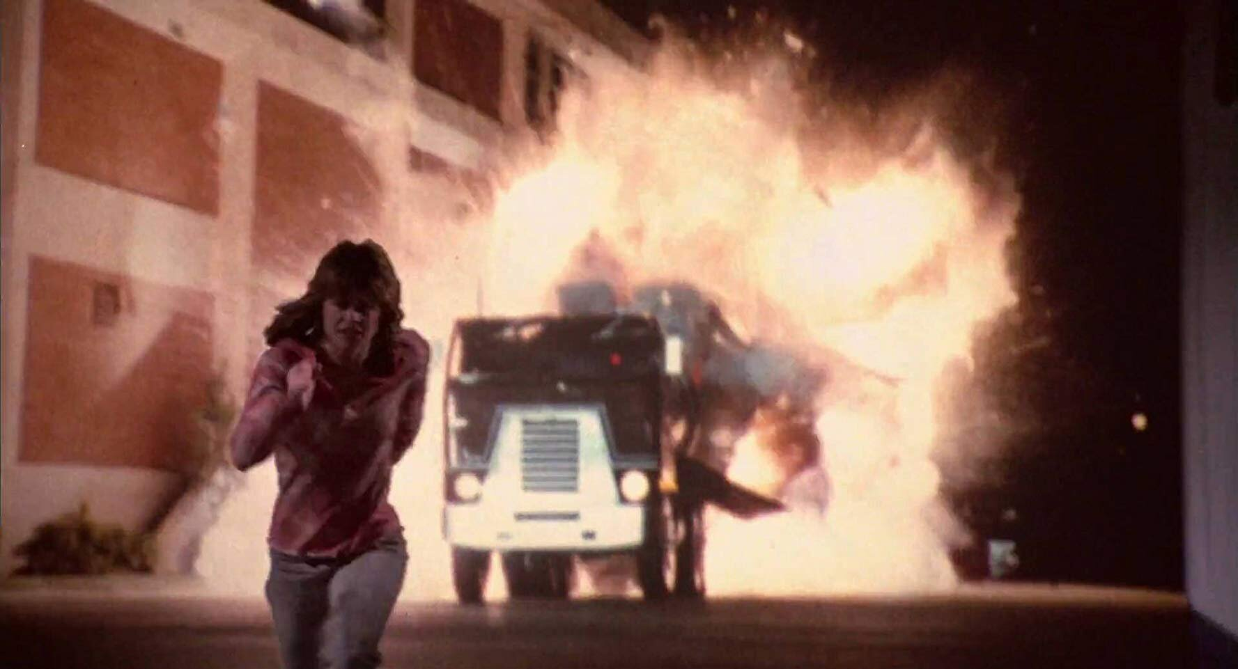 Tanker truck explosion as rear-projected behind Linda Hamilton.