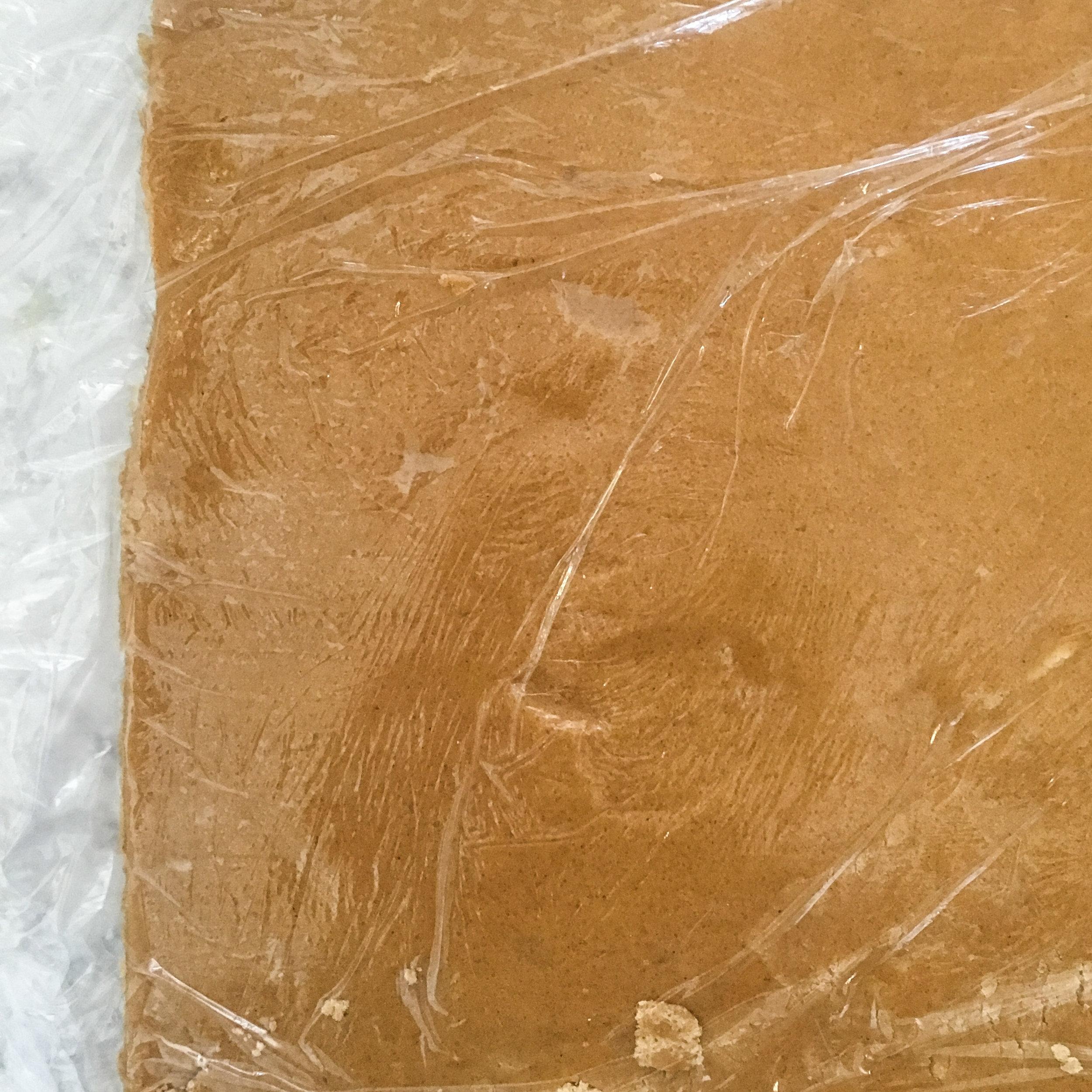 Rolling out gingerbread dough between cling film || Rachel Loewens