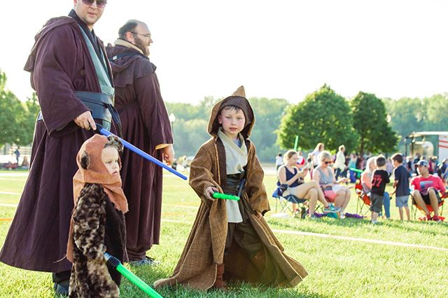 The @battle4kc is just one week away! Come hang out with us on May the 4th for a day packed with Star Wars-themed fun! Exploring Roots is so stoked to be this year's charity recipient!!! Join us for food, drinks, the world's largest light saber battle, live music and:  2:00pm - gates open  2:30 - Yoga with Yoda hosted by @jesseandrosayoga, followed by photos with Yoda at Yoda's Hut, Jedi mindfulness classes, and primitive fire starting skills classes at the Tusken Raider Village.  3:30pm - EEMS, the ukulele loop artist  5:00pm Kadesh Flow's Deshtet  6:30pm - musical performance by the Kansas City Social Symphony  7:30pm - Costume Contest  8:00pm - light saber battles begin  Photo courtesy of @battle4kc