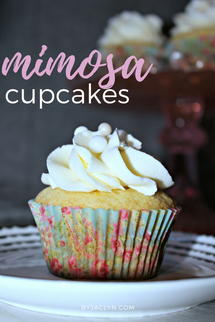 Mimosa Cupcakes: A delicious moist orange cake brushed with an orange champagne syrup and topped with a sparkly champagne buttercream!