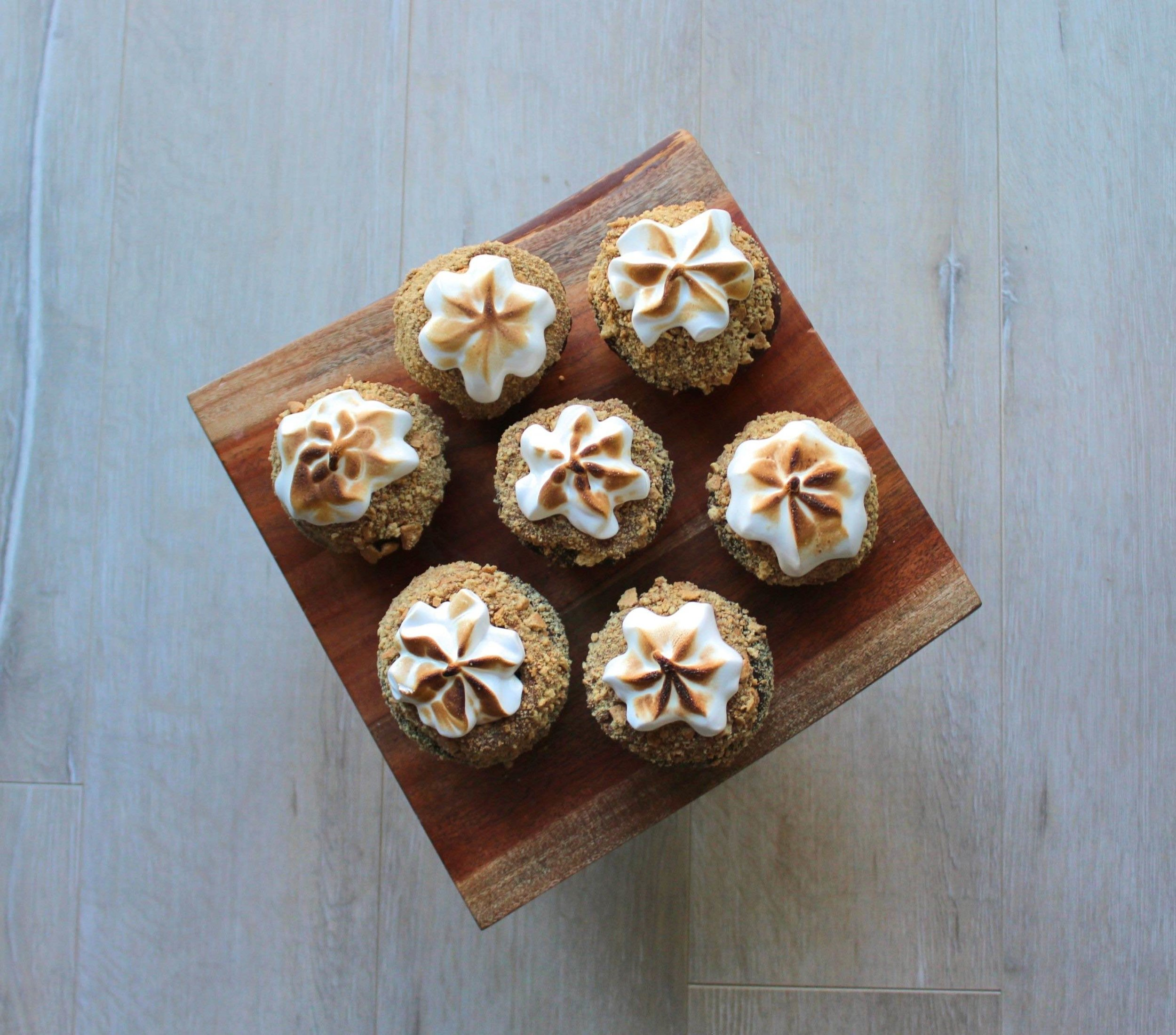 S'more Cupcakes: Chocolate Cupcakes with graham crackers crumbs and meringue frosting