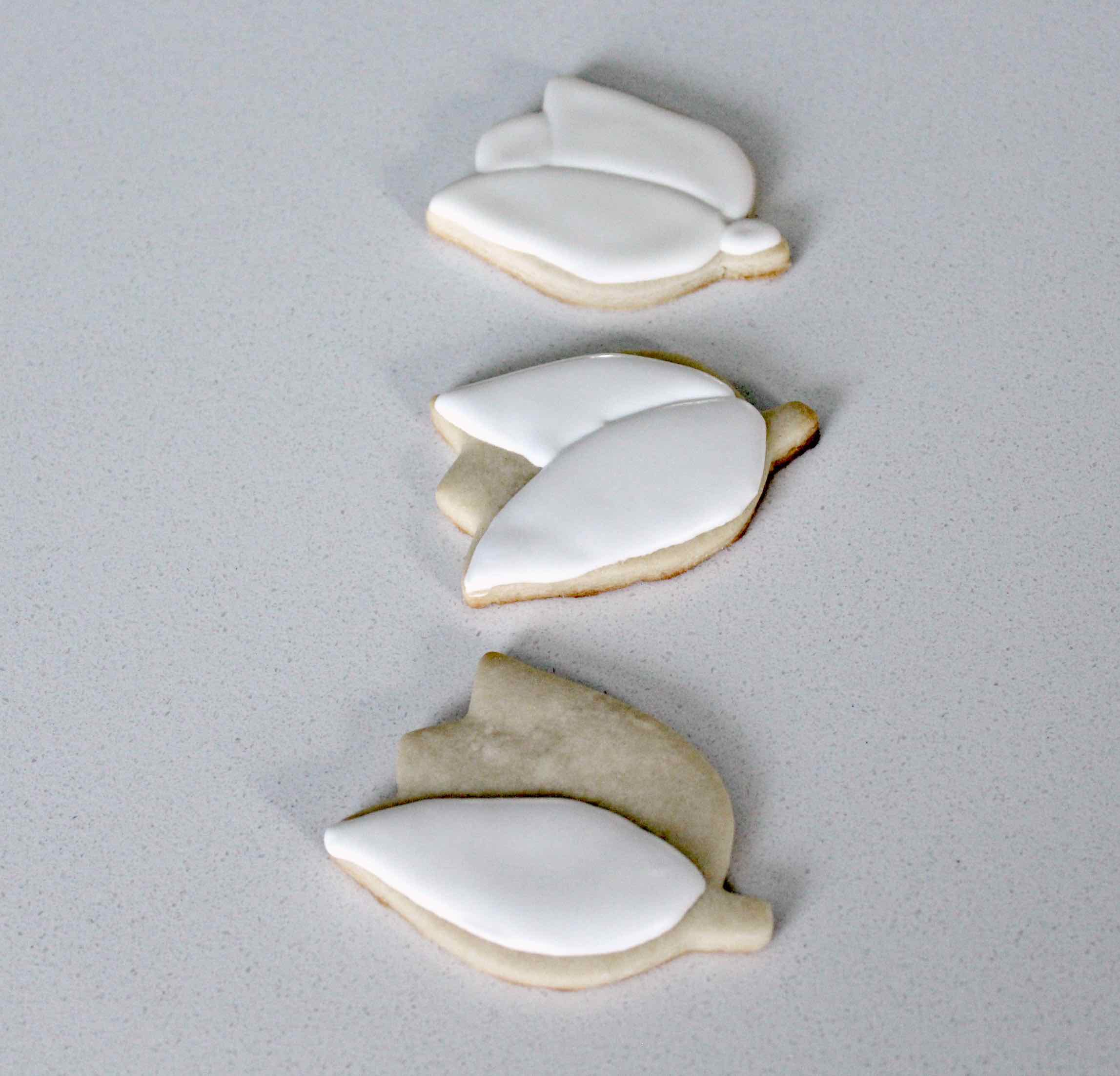 Steps by step how to flood tulip sugar cookies for a cooke bouquet