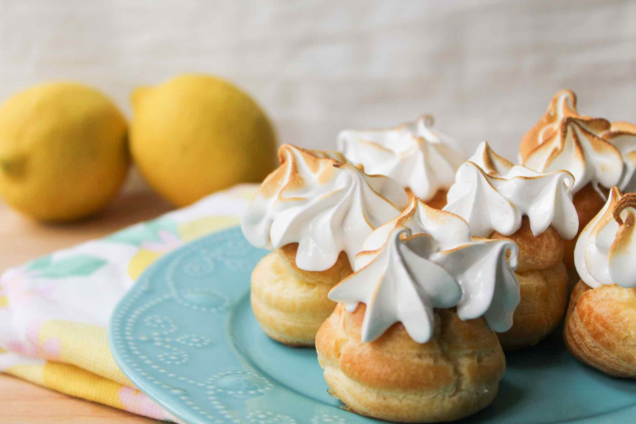 Cream Puffs filled with a lemon curd and topped with toasted meringue