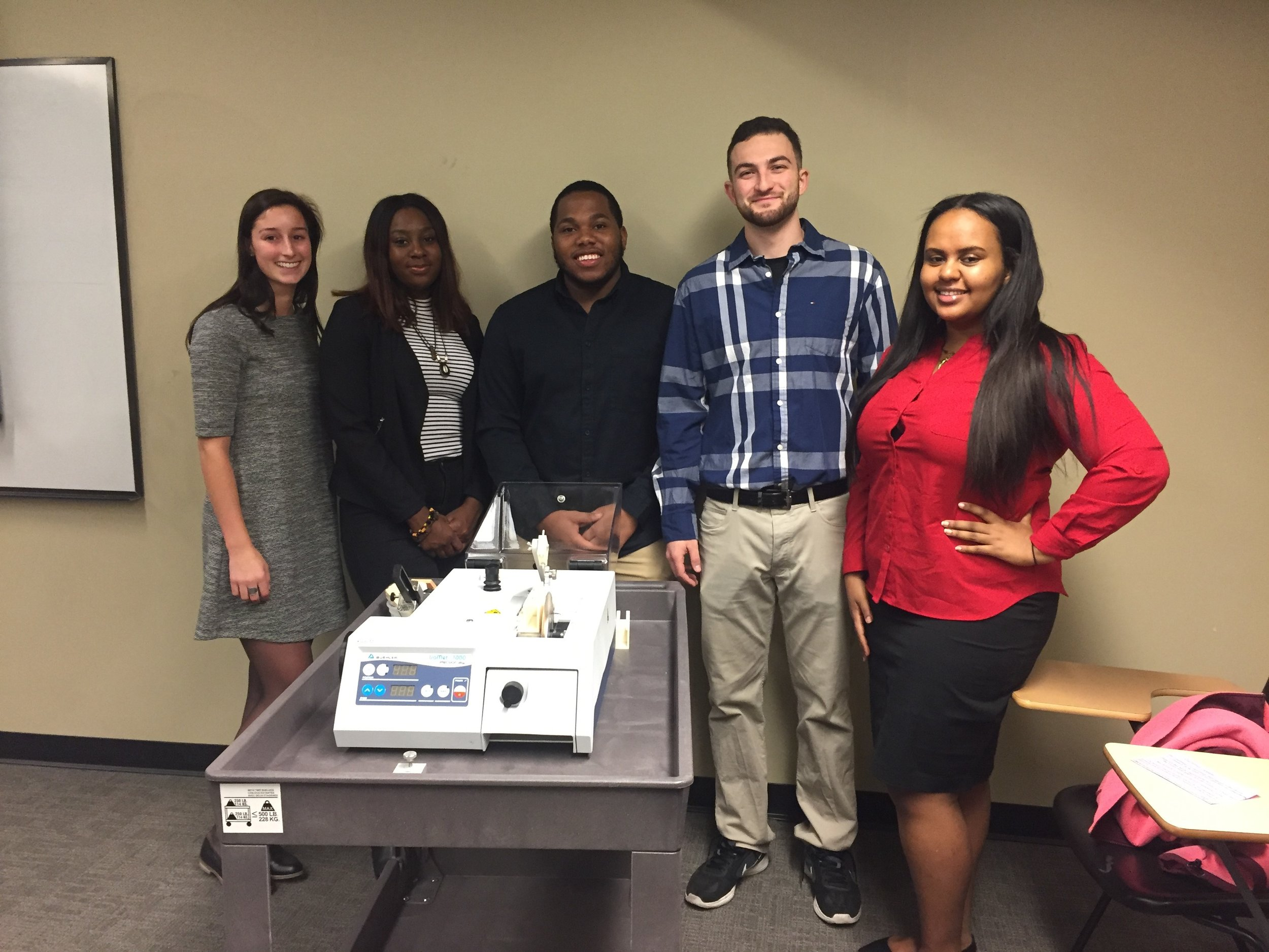 - BONE NOTCHER TEAM (2016-2017)Our team is 3D printing and building a portable and adjustable device that integrates with a low speed saw and can be used to create small controlled notches into human bone specimens for fracture toughness testing. (From left to right: Talia D'Ambruoso, Nengi Charles-Ogan, Luc Pierre-Louis, Eddie Floyd, Mekides Mezgebu)