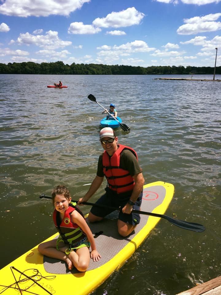 father and daughter kayaking on Lake Decatur
