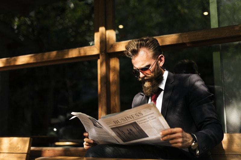 businessman reading newspaper.jpg