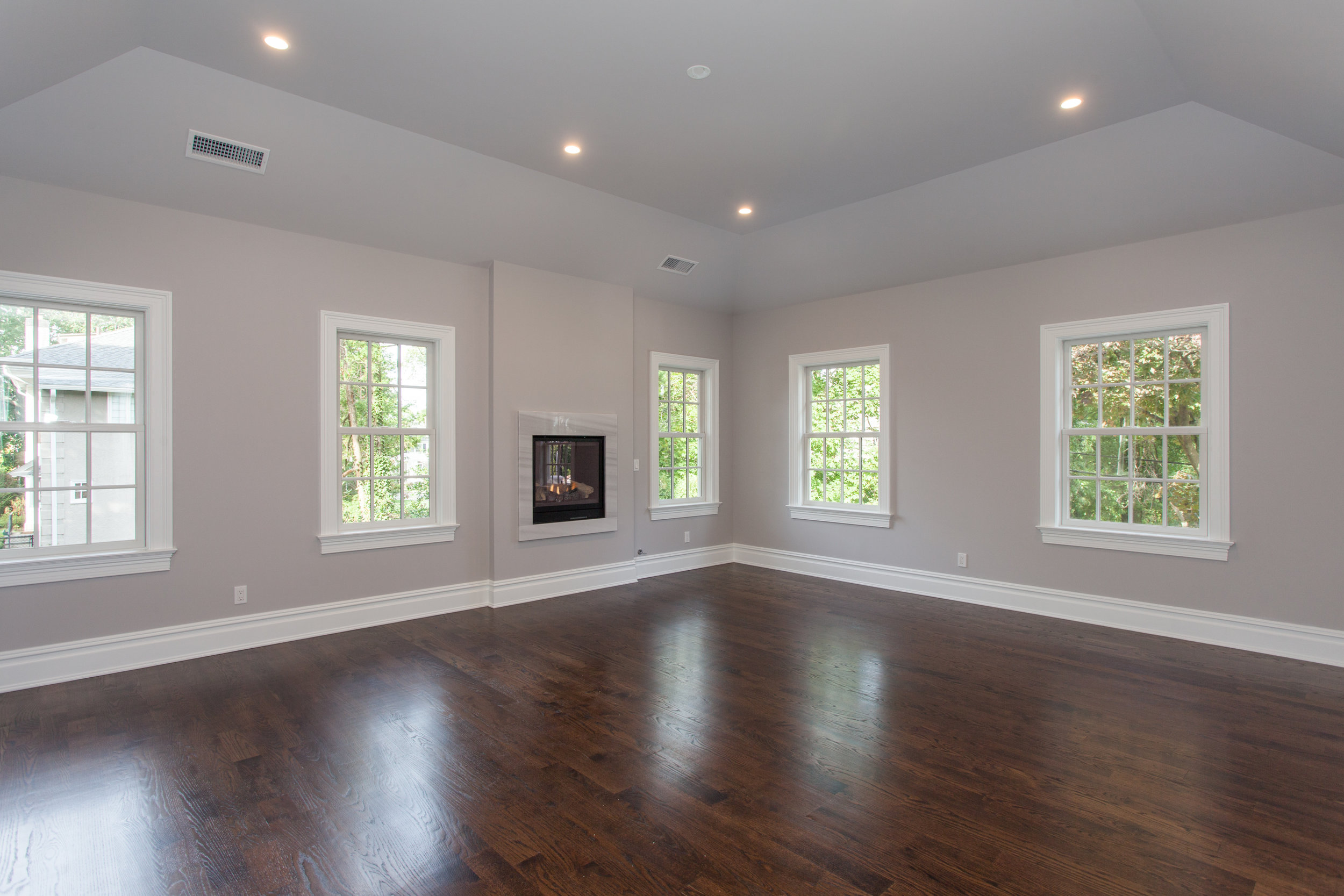 GRAND MASTER SUITE |  Boasts 11 ft tray ceiling and remote-controlled fireplace.