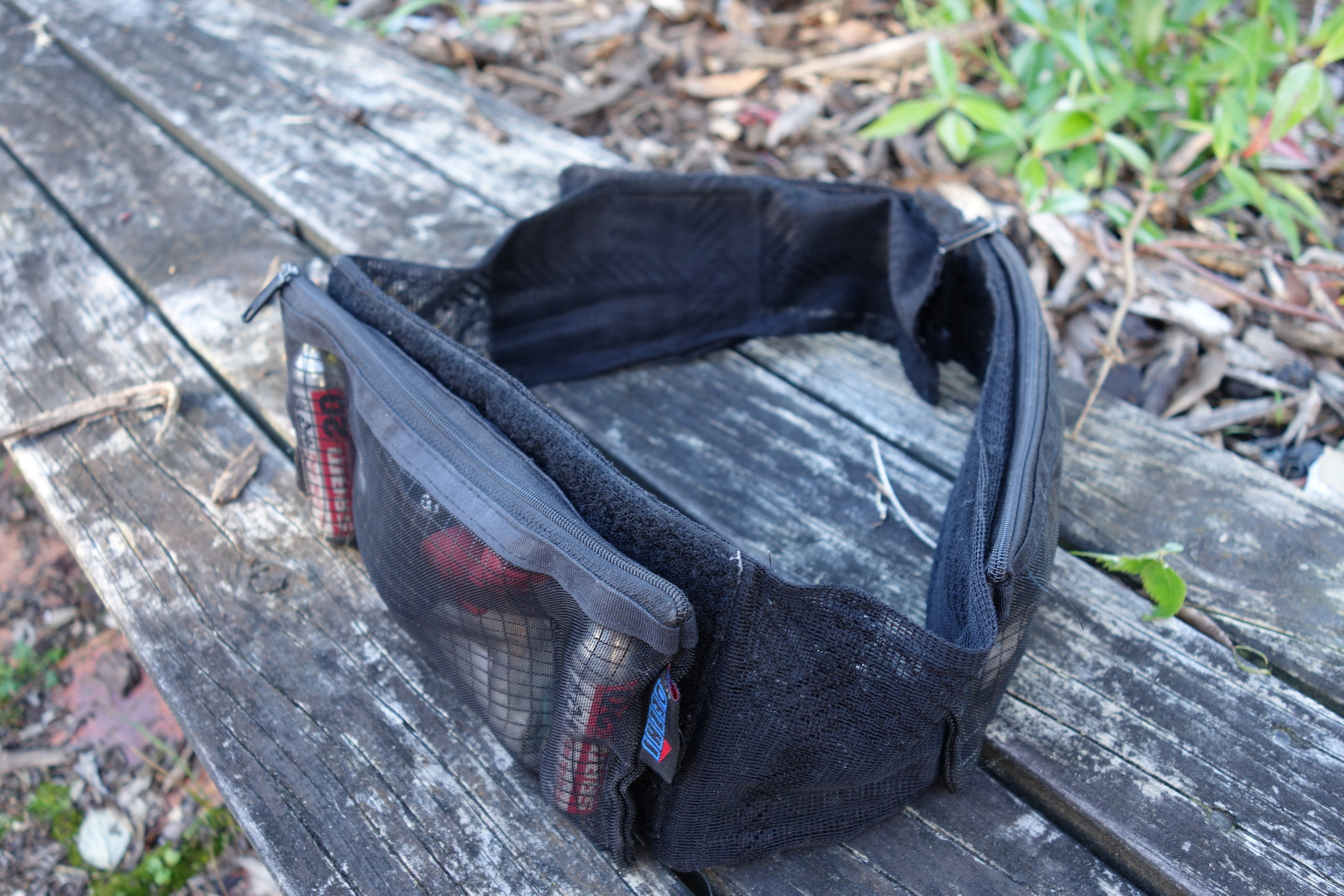 The Batman and I collaborated on this under-jersey waist belt. I wasn't always a media guru.In the 70's while still at school I formed a marble bag sewing empire, so It was pretty natural for me to move into high-end mountainbike wear manufacturing. This prototype I made from curtain mesh and a couple of pencil cases from the $2 shop. It doubles as a corset to make me look more like The Batman.