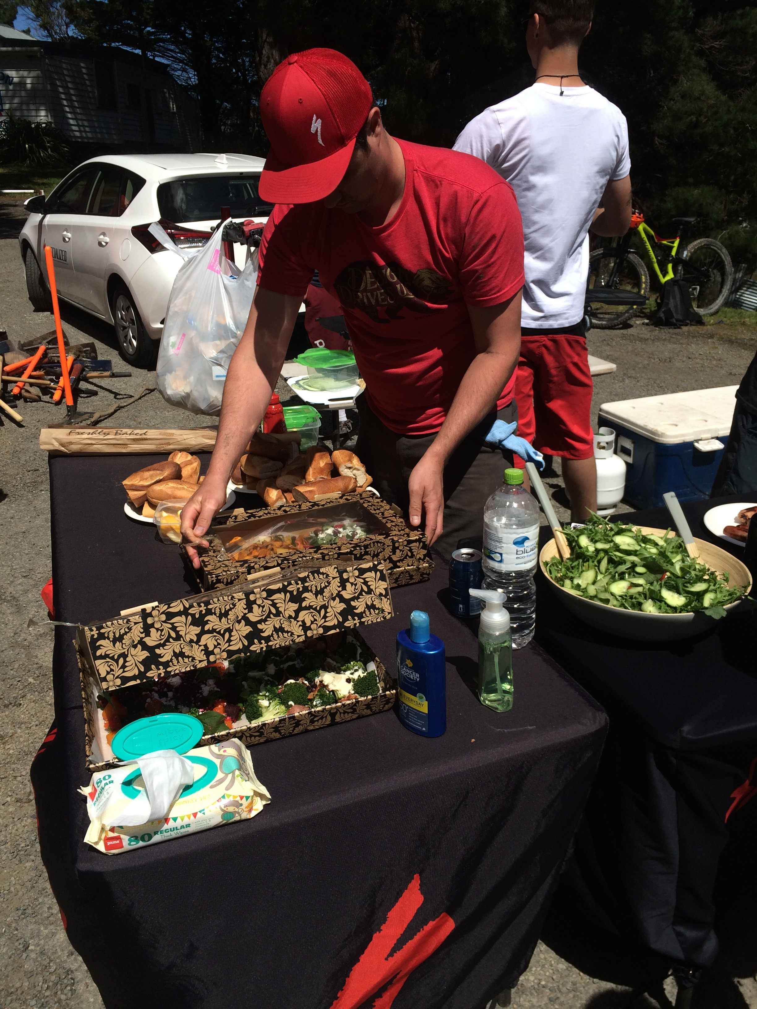 James whips up a couple of salads before the crews return.