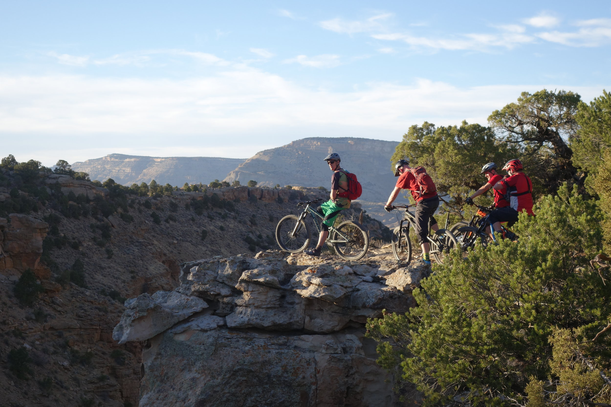 The trail comes very very close to the edge many times especially on the faster loose sections of descending trail. I was crapping myself that I would miss a bend in the trail and plummet to my death. The boys aren't just posing here. It's a fast sketchy right hand bend that catches the rider unawares. Tim climbs ladders for a living, he wasn't fazed at all. (No he's not a window cleaner, he rescues cats from trees and poses half naked in calendars for a job).