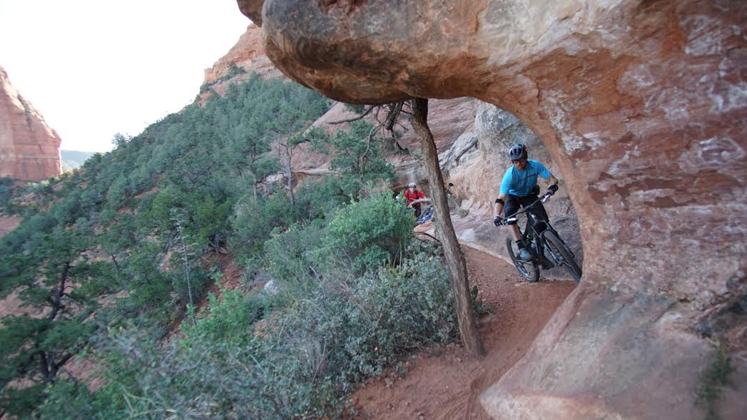 This part of Hangover trail was a dirt ledge sandwiched in a steep slickrock face. It was super techy with roots and rocks waiting to clip your pedals and rock overhangs waiting for wide bars to graze through. photo: Jeff carter