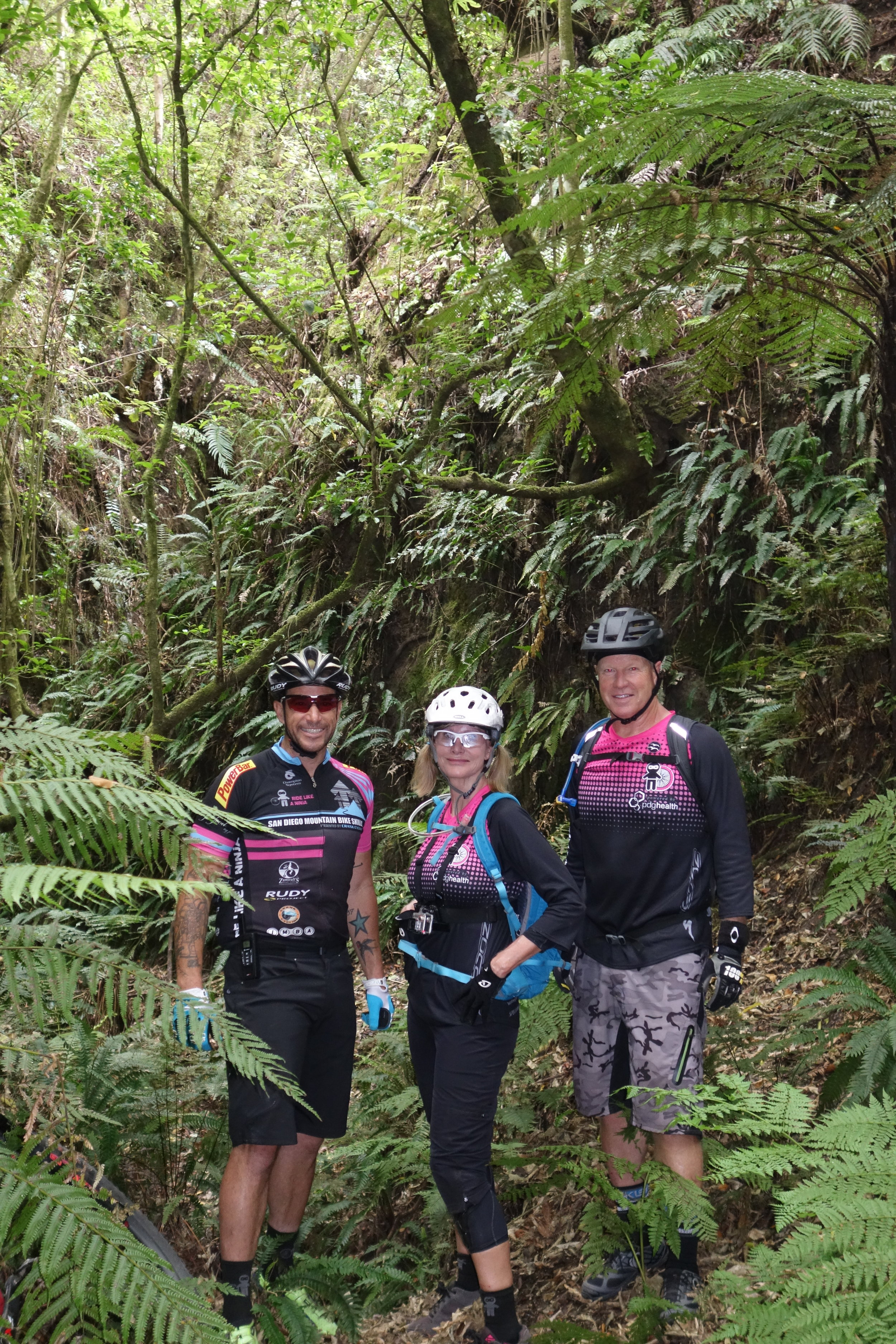 Welcome to the jungle. Richard found a dark deep ravine off the side of the trail so Patty and Jim rode back to check it out.
