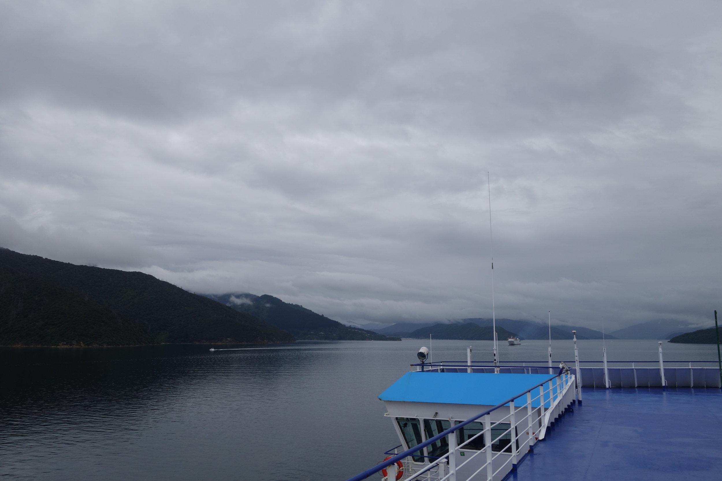 Heading into the Malborough Sounds. Oh shit, looks like rain. Top deck with Bluebridge