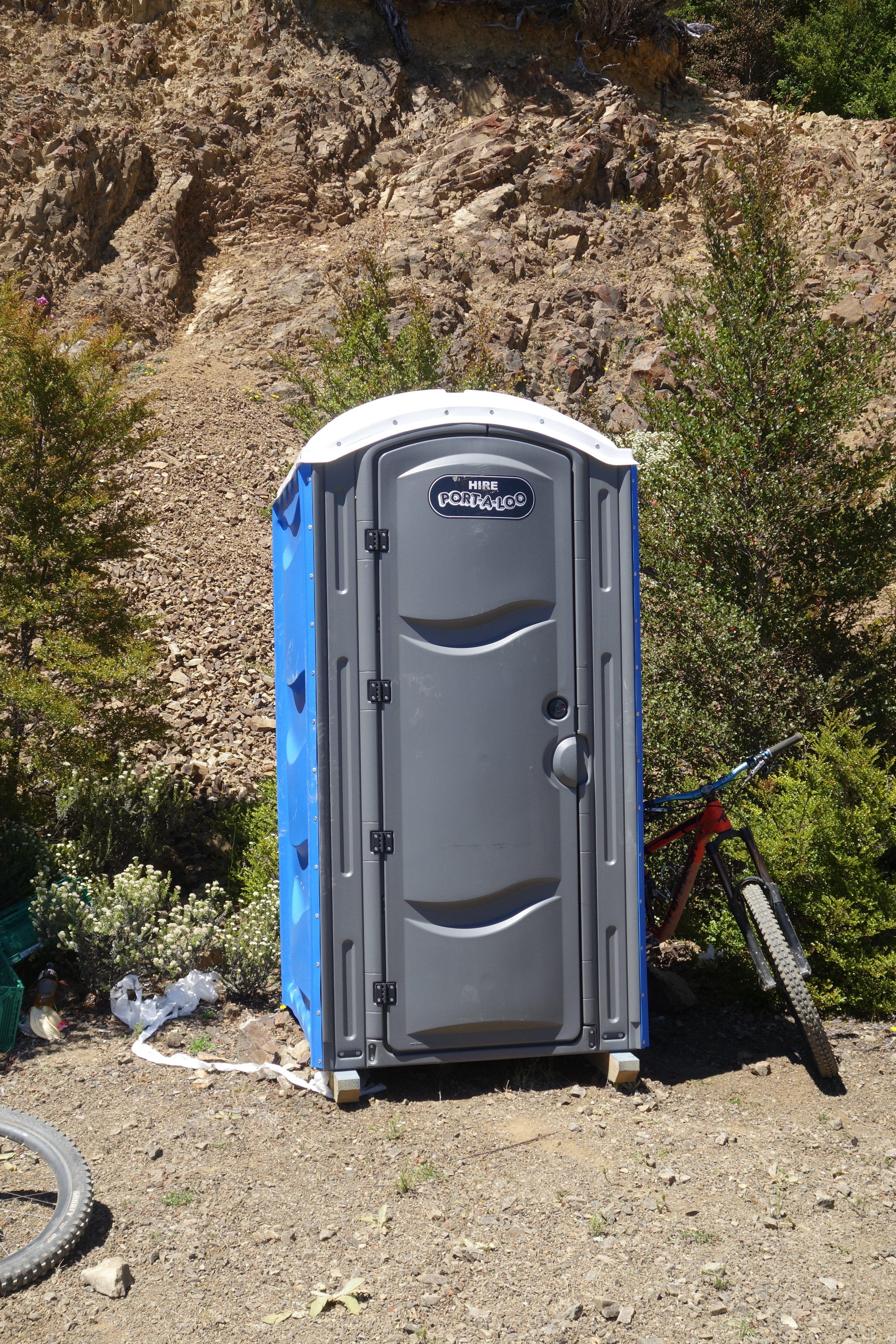 I just love visiting the Port-a-loo on a hot day. Especially when it's parked right where the shuttle drops of the riders. After race nerves jettisoned my lower intestine, I emerged to a queue of five girls about to be seriously nasally assaulted. Sorry girls.