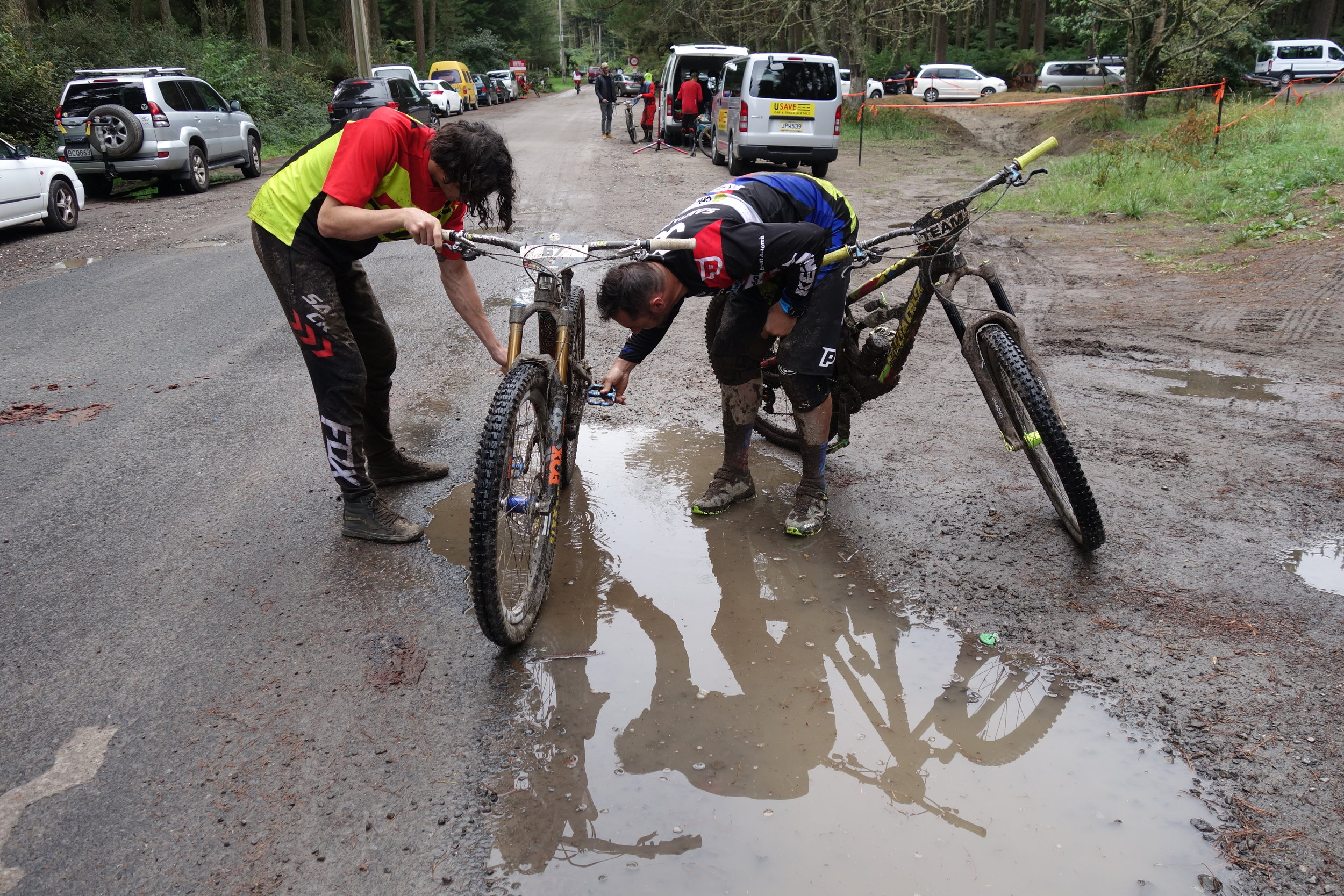It's looking pretty muddy from last nights rain as we spy Cedric Cracia and Josh Bryceland washing their bikes in a puddle. I've only been here 5 minutes and i've bumped into three legends. Crankworx huh! Awesome.