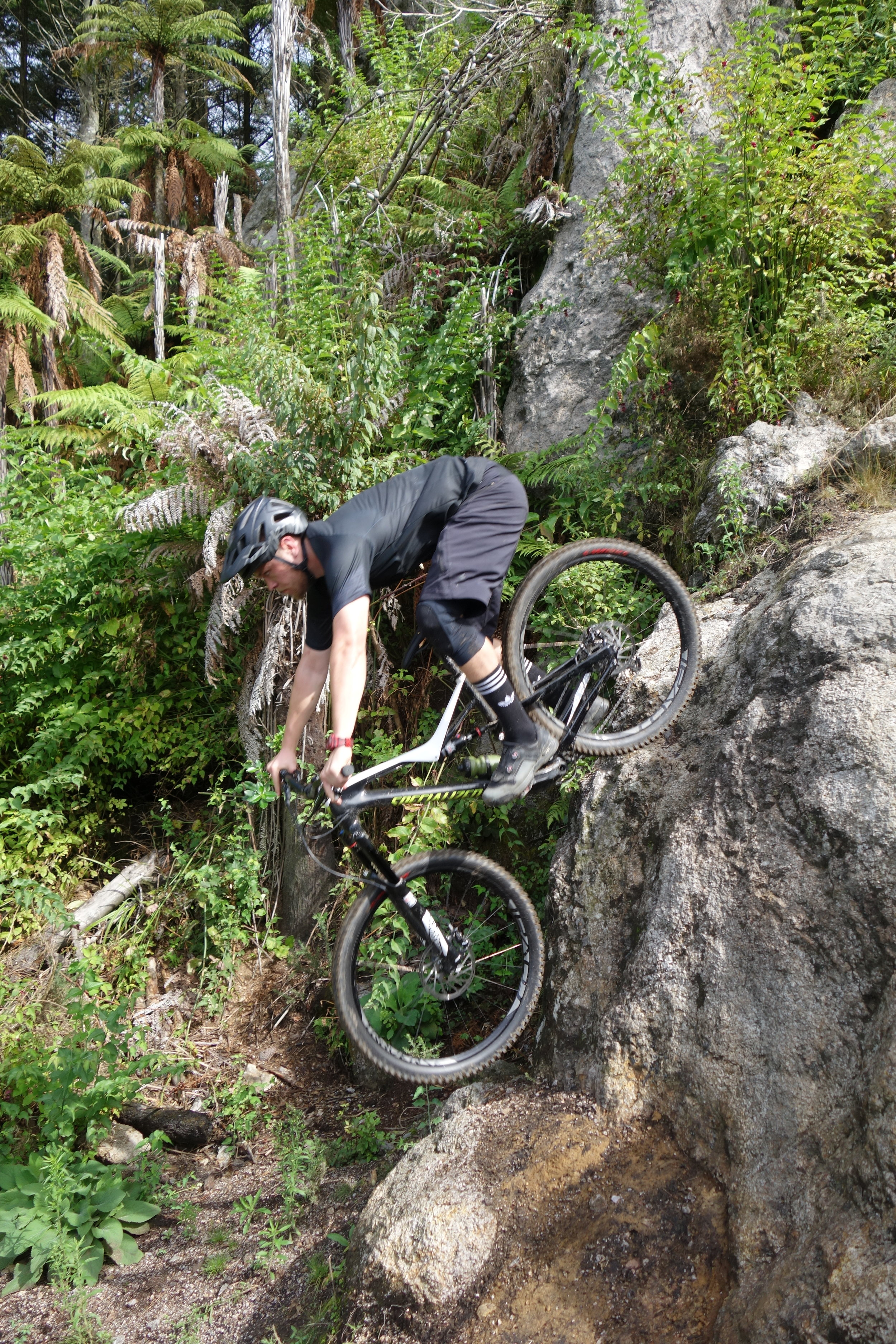 The rock drop on Boulder Dash is pretty damn steep when viewed from the side (and above). It's borderline over the bars if you try and roll it. Caleb again...RAD!