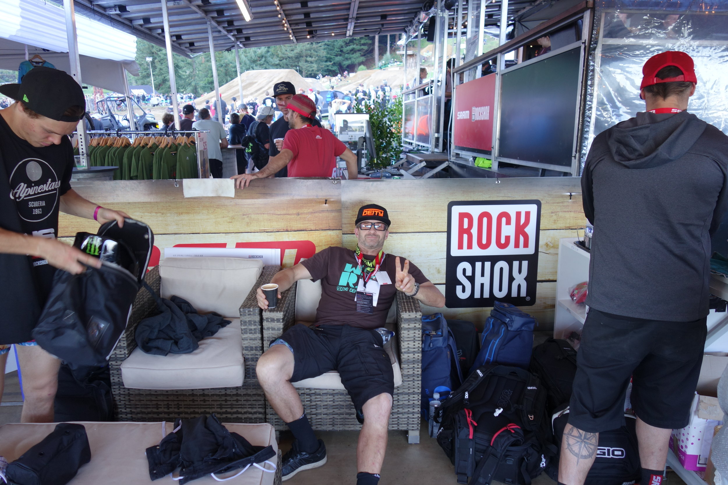 I'm exhausted from all this work already so I head to the Sram tent and take a break in Brandon Semenuks spare seat hoping he'll pop over for a chat.....  photo: Wombat.