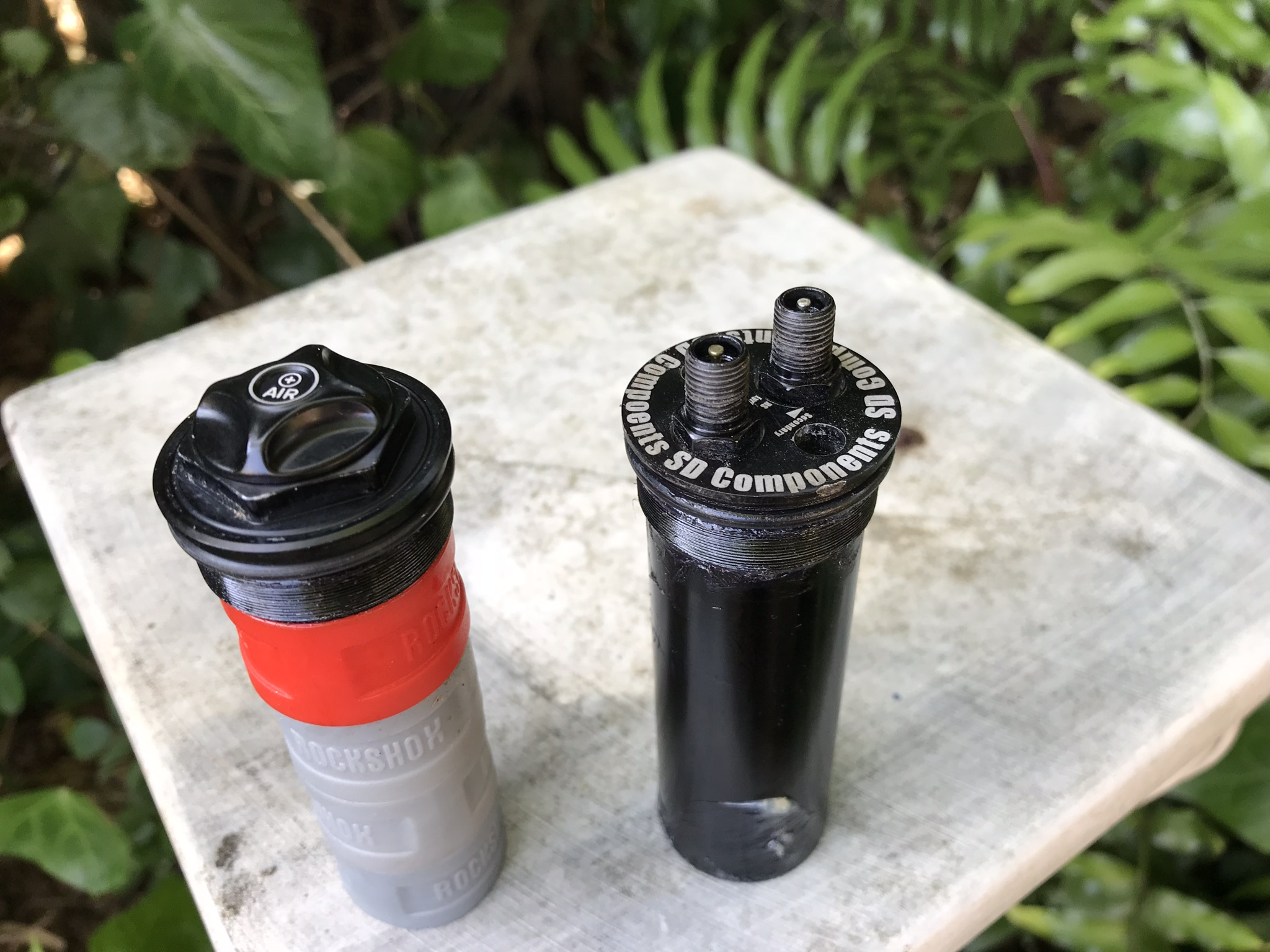 My stock air cap on left with 4 volume spacers to show the similar size to the DVC on right