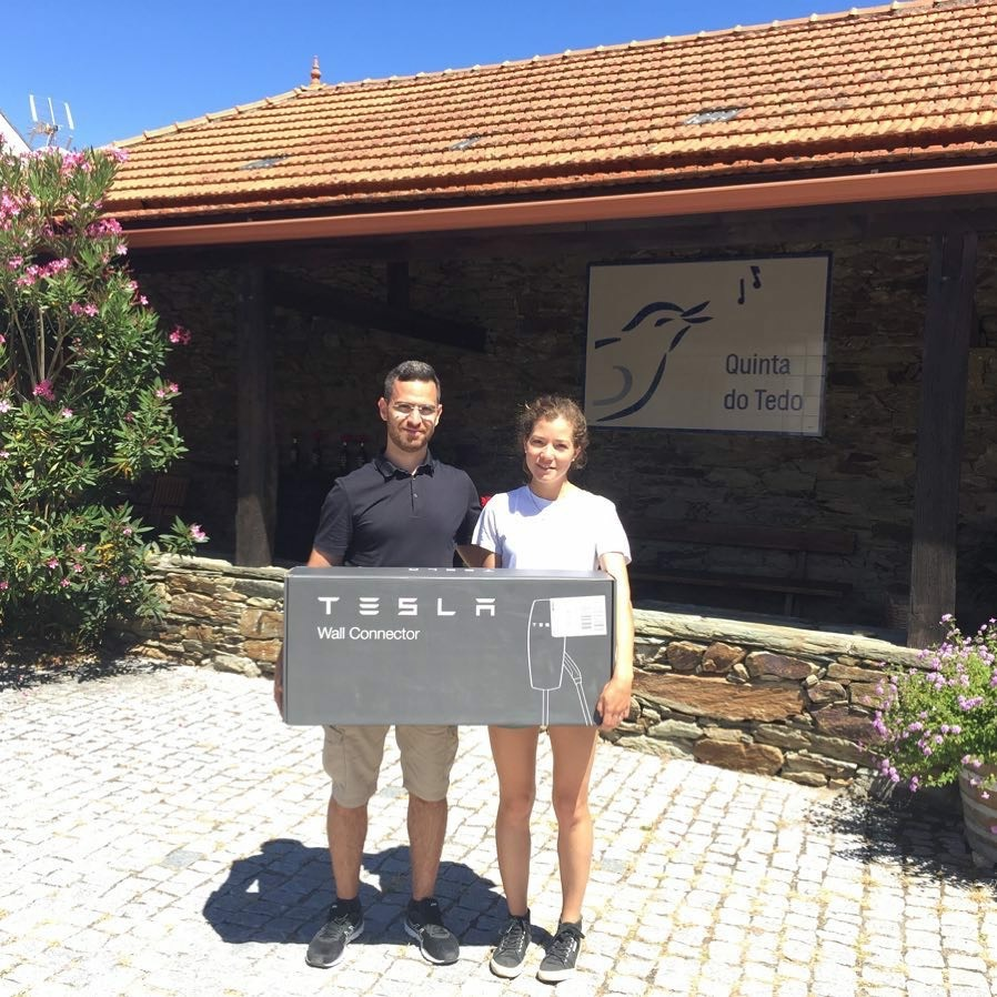 Proud to be part of the EV movement! Photo of Sérgio Costa from Portugal EV Tours and Odile when our Tesla Wall Connector arrived.