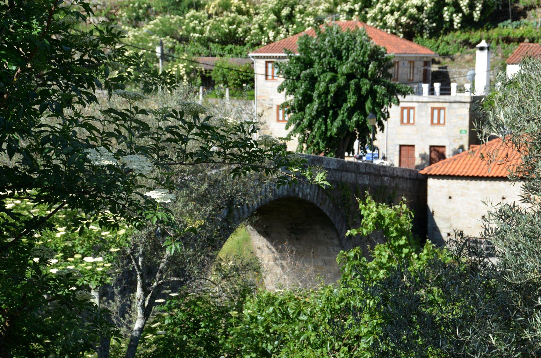 Crossing over Granja's Roman bridge.