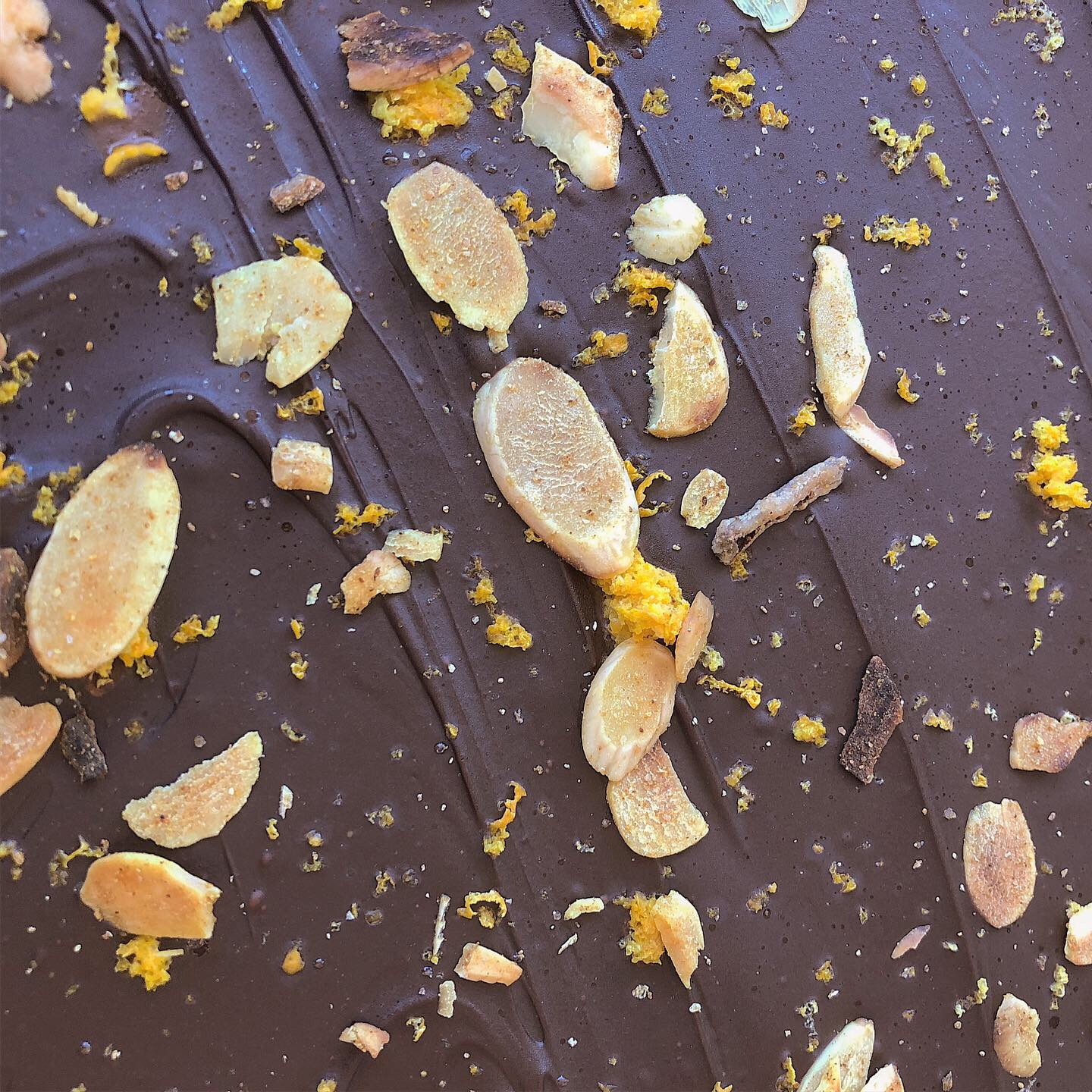 Toasted almonds and orange peel milk chocolate pairs with our Fine Tawny.