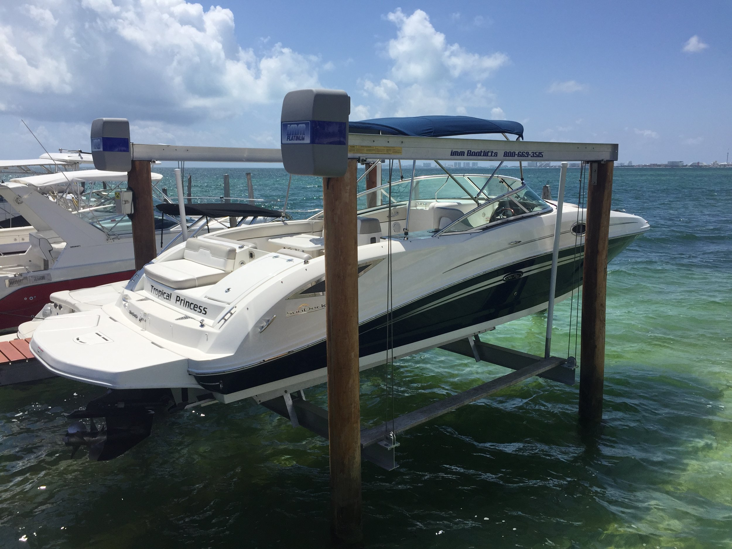 IMM Platinum 4 post boat lift by Boat Lifts Of South Florida in Islamorada, Fl.
