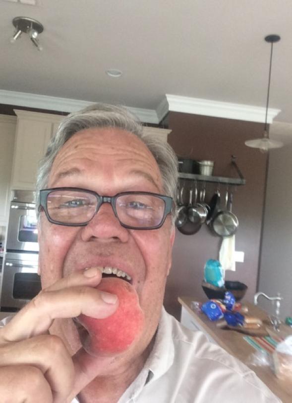 Jolie Vue Farms - Glen Boudreaux loves his peaches.