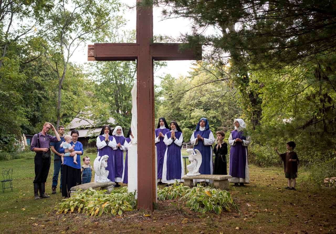 After community dinner and before they all say good-bye, they pray to Mother Mary at Children of Mary in Newark, Ohio, on September 24, 2016.