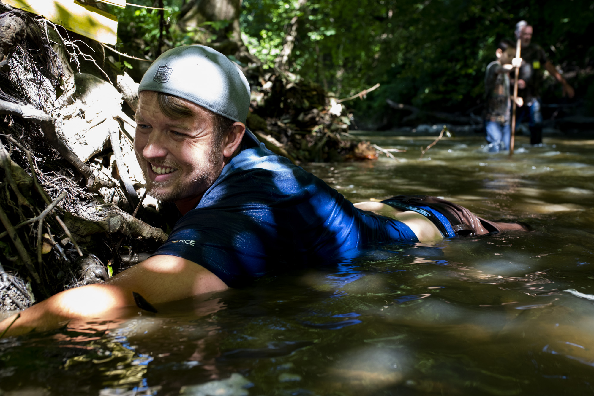Joey Clemens , of Murrysville, reaches into a hole under tree roots as he hunts for snapping turtles.