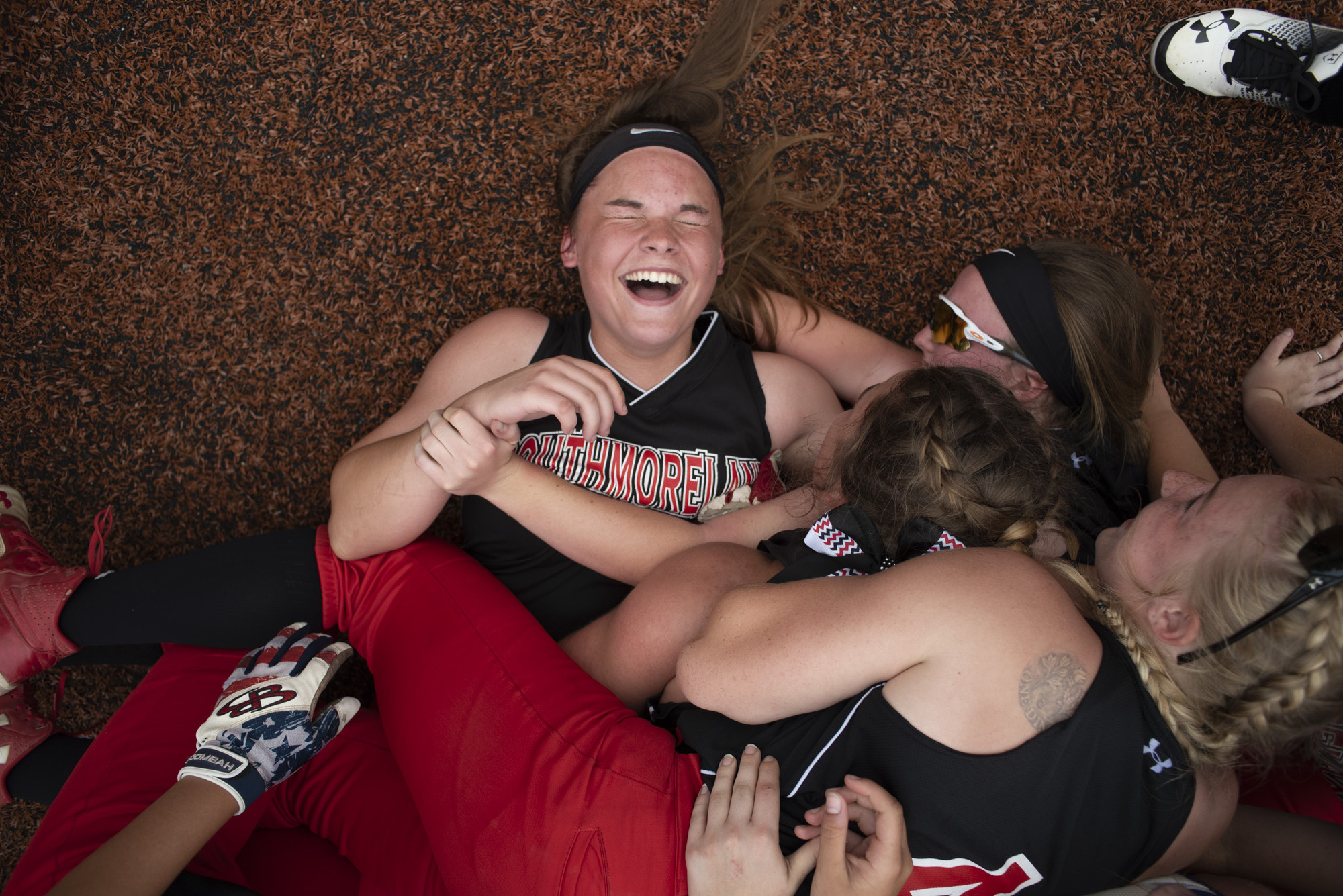 Southmoreland's Varsity Softball team, dog piles on pitcher, Jess Matheny, after the WPIAL softball championship triple on Thursday, May 31, 2018.