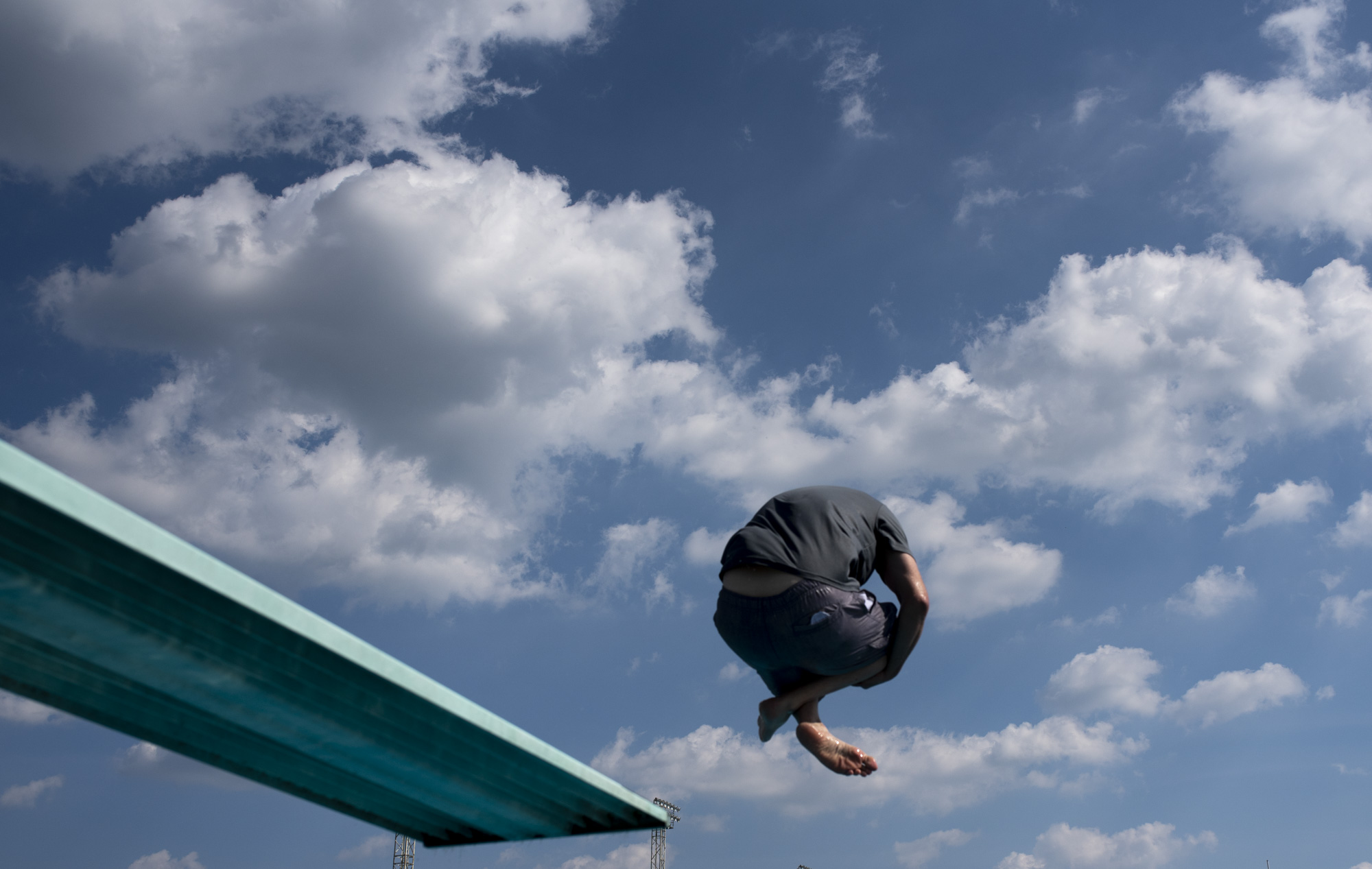 Joe LeBlanc, of Latrobe, jumps off of the diving board at the Latrobe Community pool with on Friday, June 29, 2018.