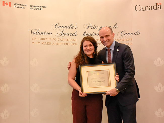 The Honourable Jean-Yves Duclos presents Valérie Toupin-Dubé with Canada's Volunteer Award for Emerging Leader (Quebec).