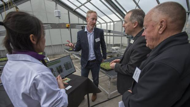 MURRAY WILSON/STUFF  Biolumic researcher Lulu He, left, and chief executive Warren Bebb, centre, take Sprout summit attendees on a tour of the new research and development centre.