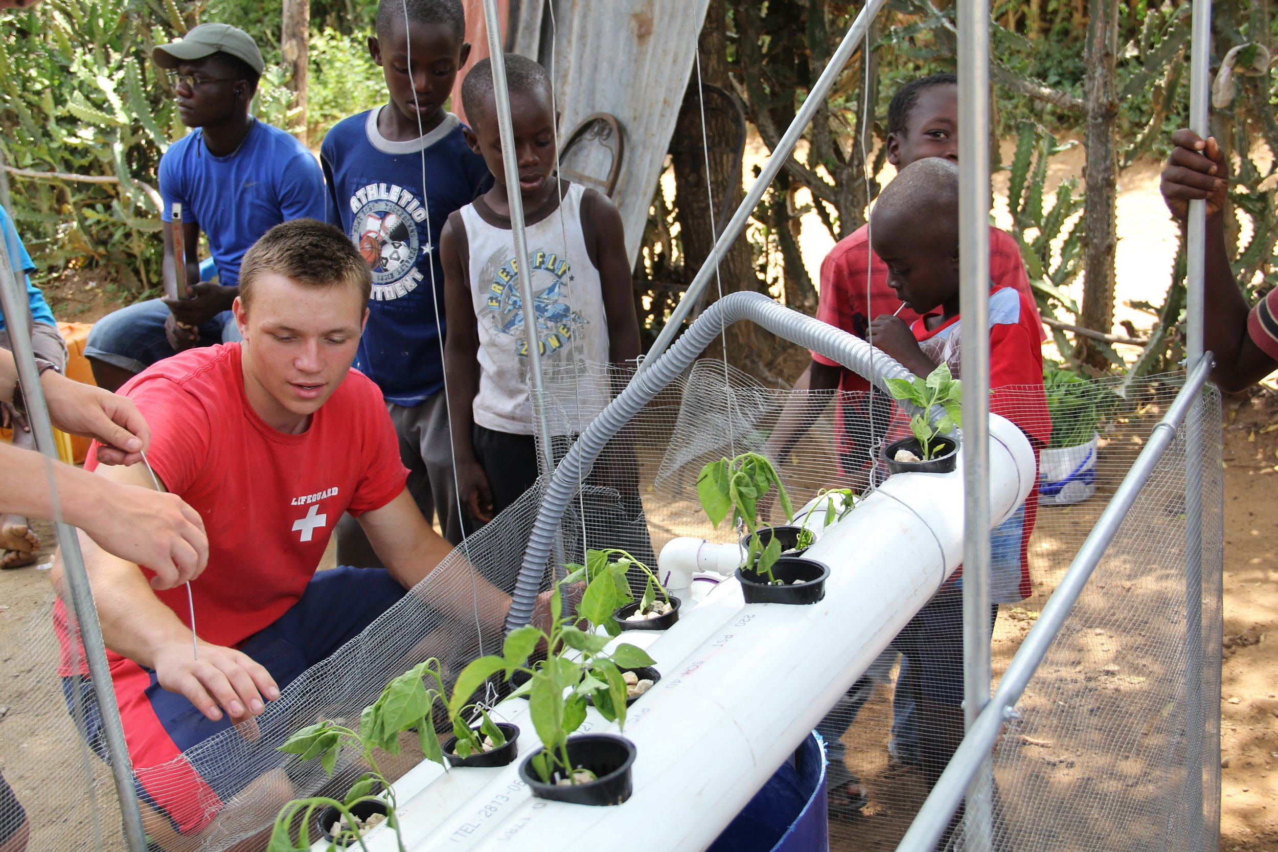 Christian Heiden '20 (ENG), center, started a non-profit organization Levo International to bring hydroponics to those in need in Haiti.